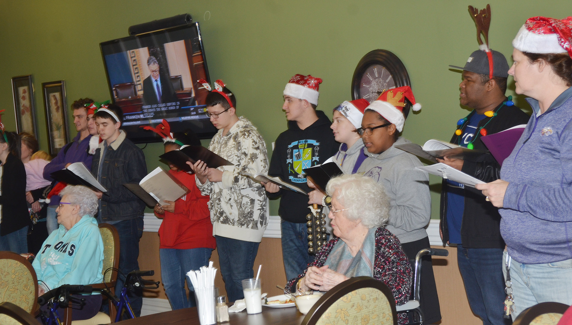 Campbellsville Independent Schools' students and teachers sing Christmas carols at Bluegrass Way.