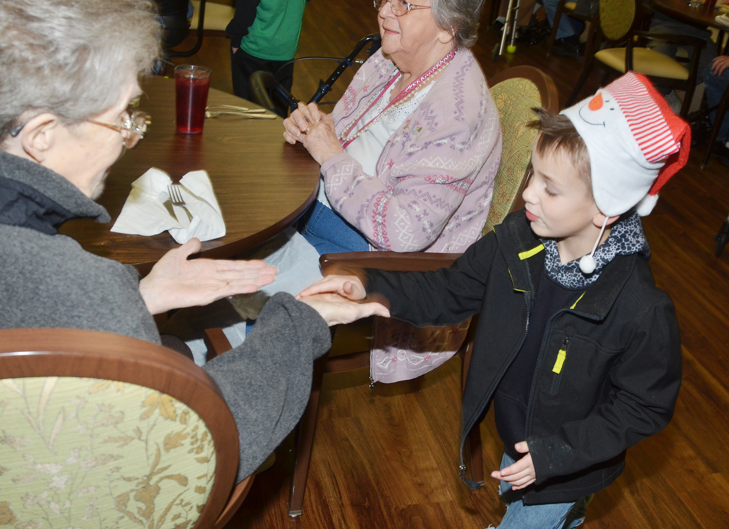 Campbellsville Elementary School kindergartener Cash Davis greets Bluegrass Way residents.