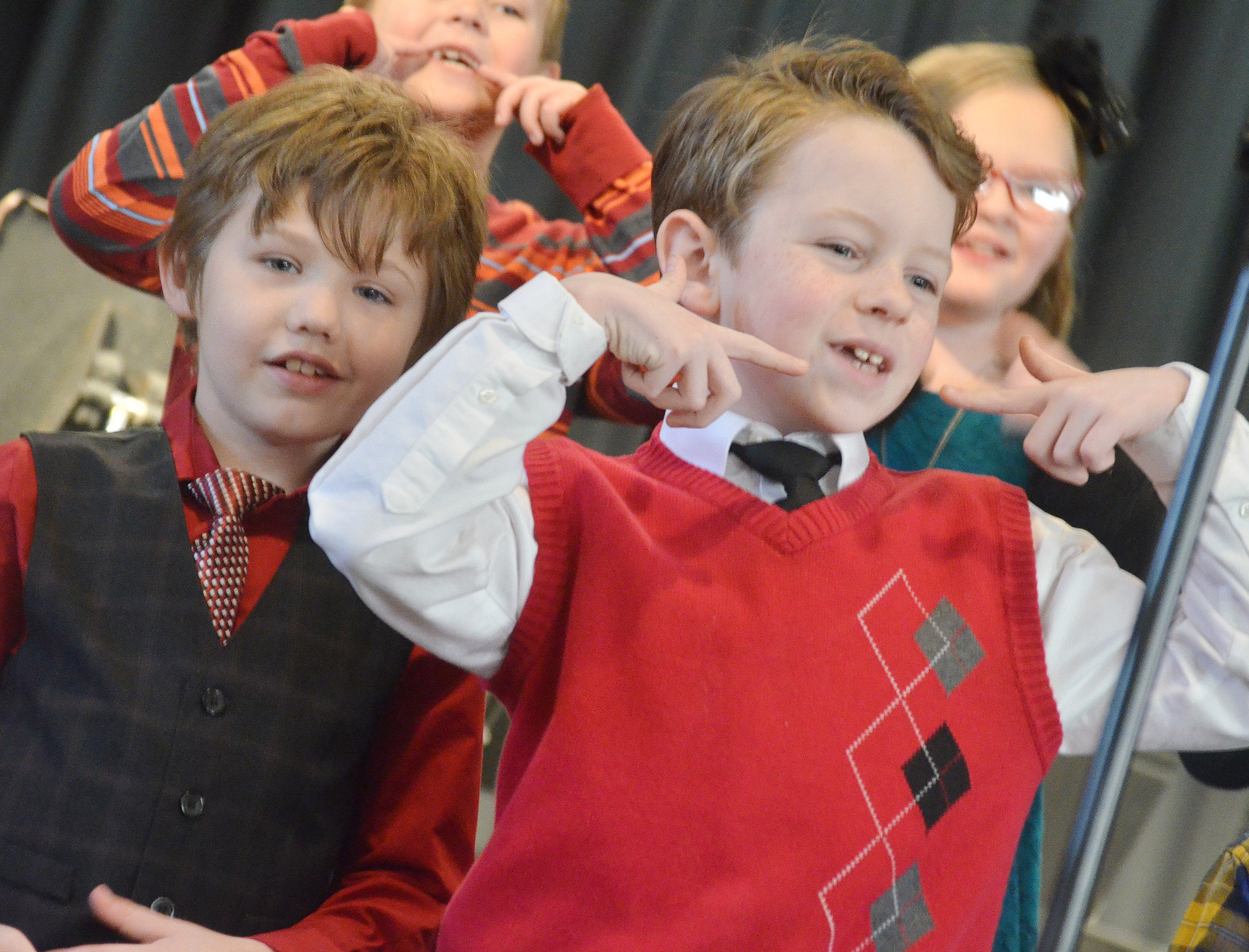 CES second-graders Lucian Abel, at left, and Jayden Cox perform.