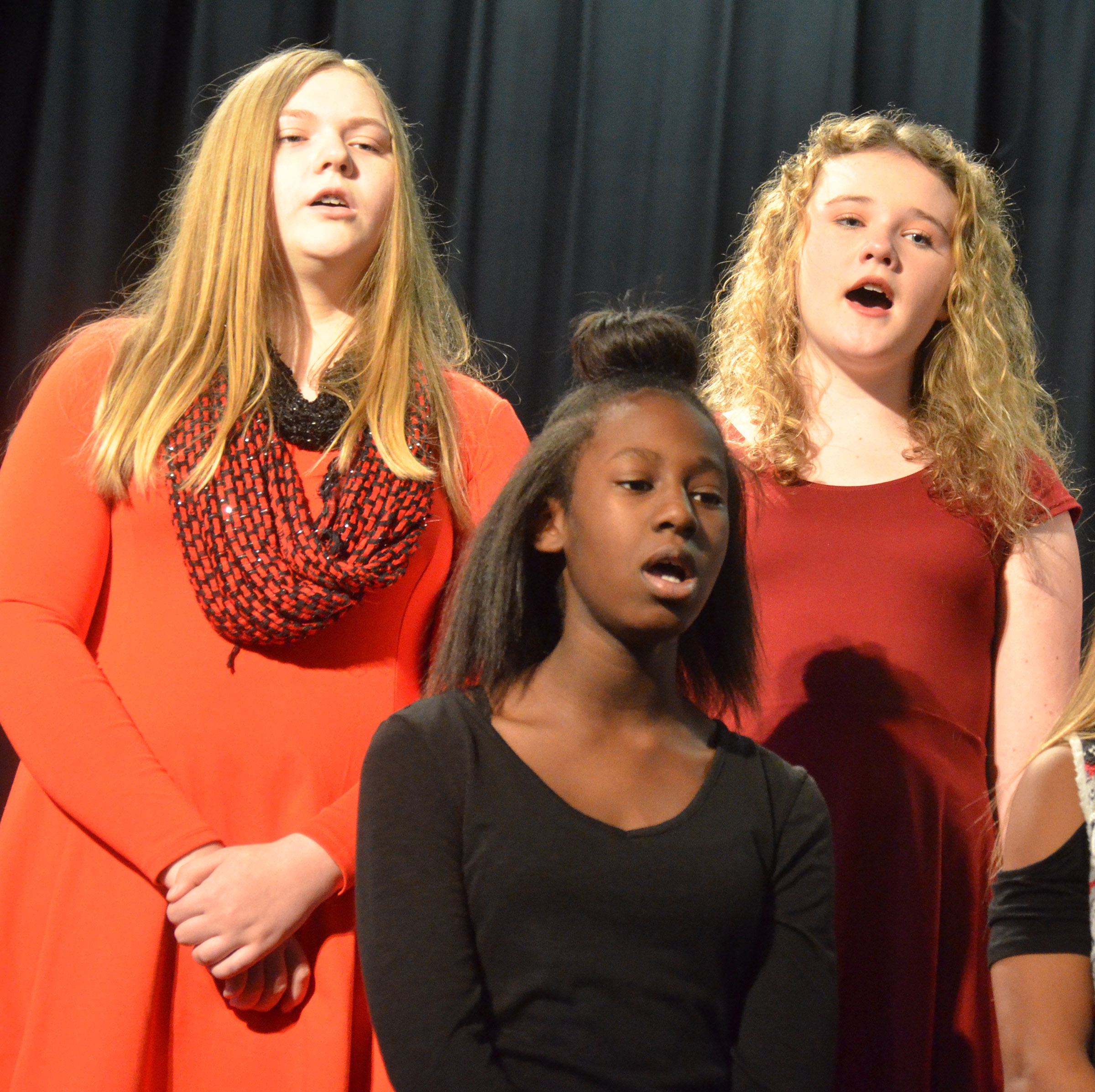 From left, CMS eighth-graders Isabella Vannice, Myricle Gholston and Abby Brisko sing.