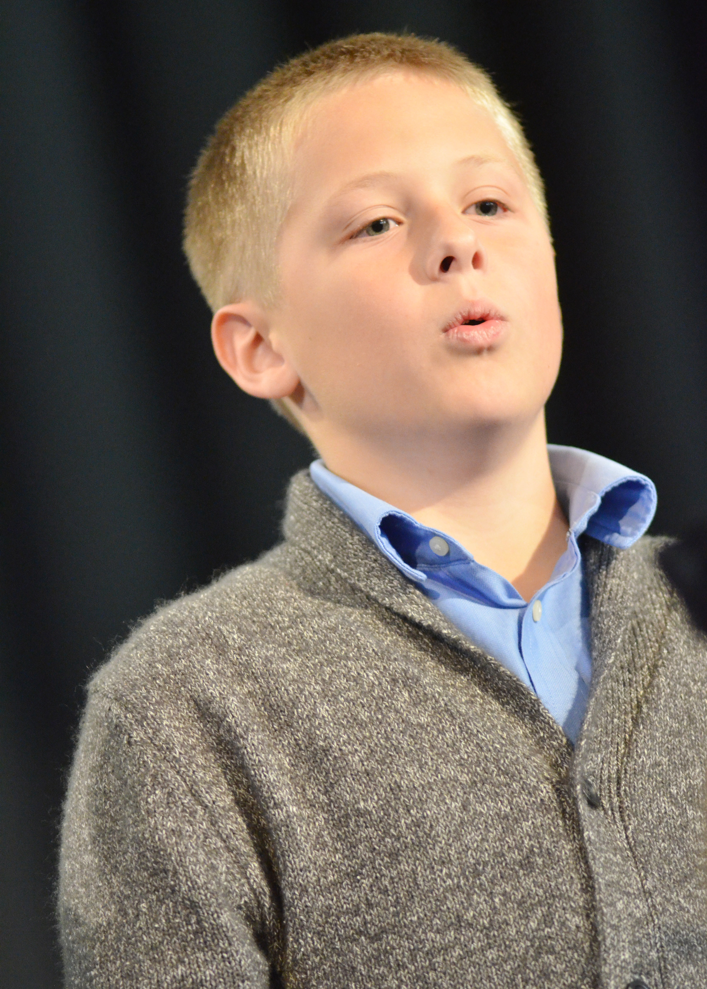CES third-grader Evan Lockridge sings.
