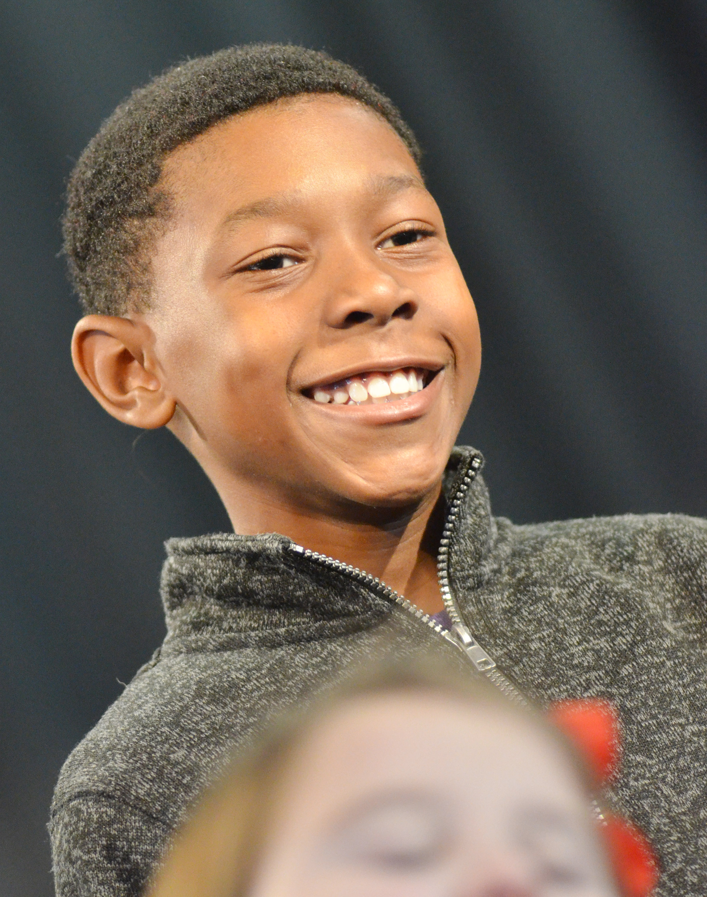 CES third-grader Jaron Johnson smiles while performing.