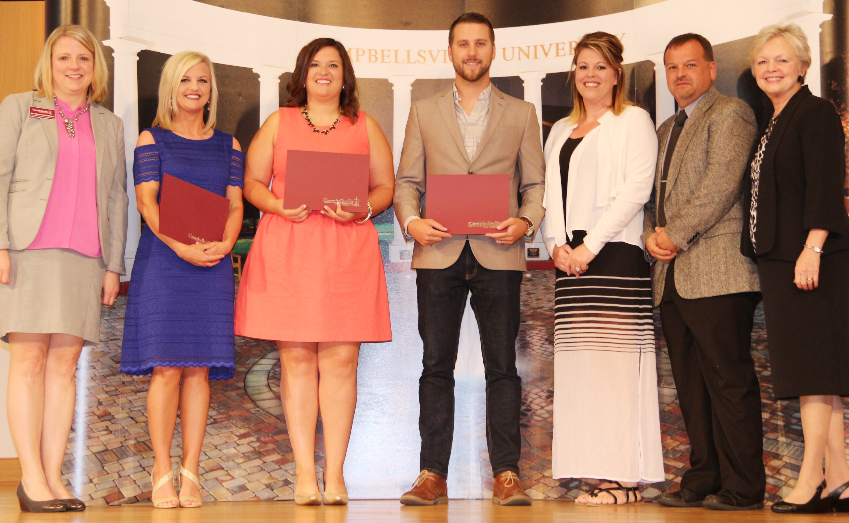 Campbellsville Independent Schools' teachers were honored at Campbellsville University's Excellence in Teaching Awards ceremony on Saturday, May 20. From left are CU Vice President for Academic Affairs Donna Hedgepath, CES kindergarten teacher Leanna Cundiff, CMS eighth-grade teacher Robbilyn Speer, CHS teacher Tyler Hardy, CMS Principal Elisha Rhodes, CES Principal Ricky Hunt and Dr. Beverly Ennis, dean of the CU School of Education.