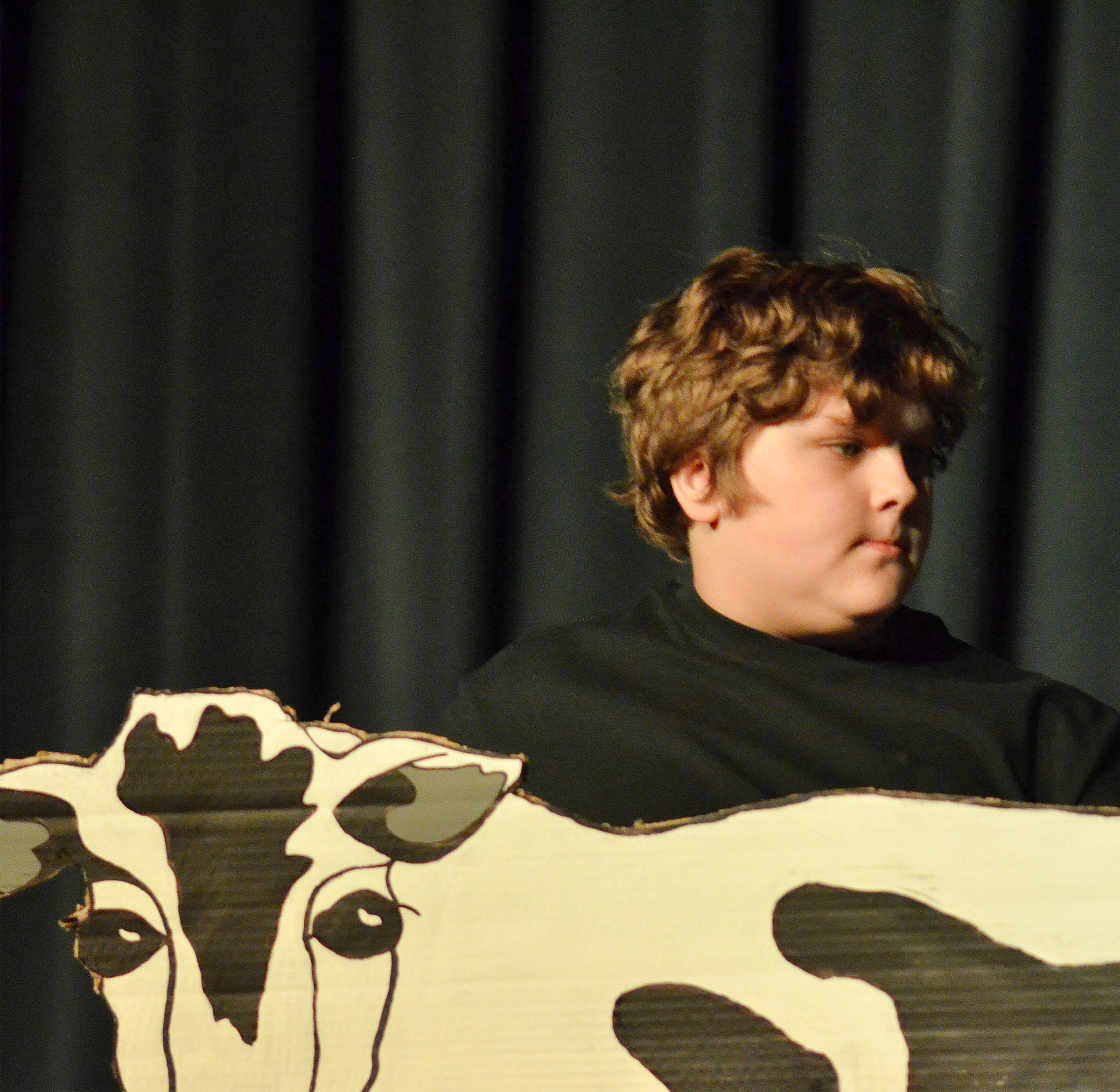 CMS fourth-grader Zeke Harris portrays a rowboat, apple tree and scary tree.