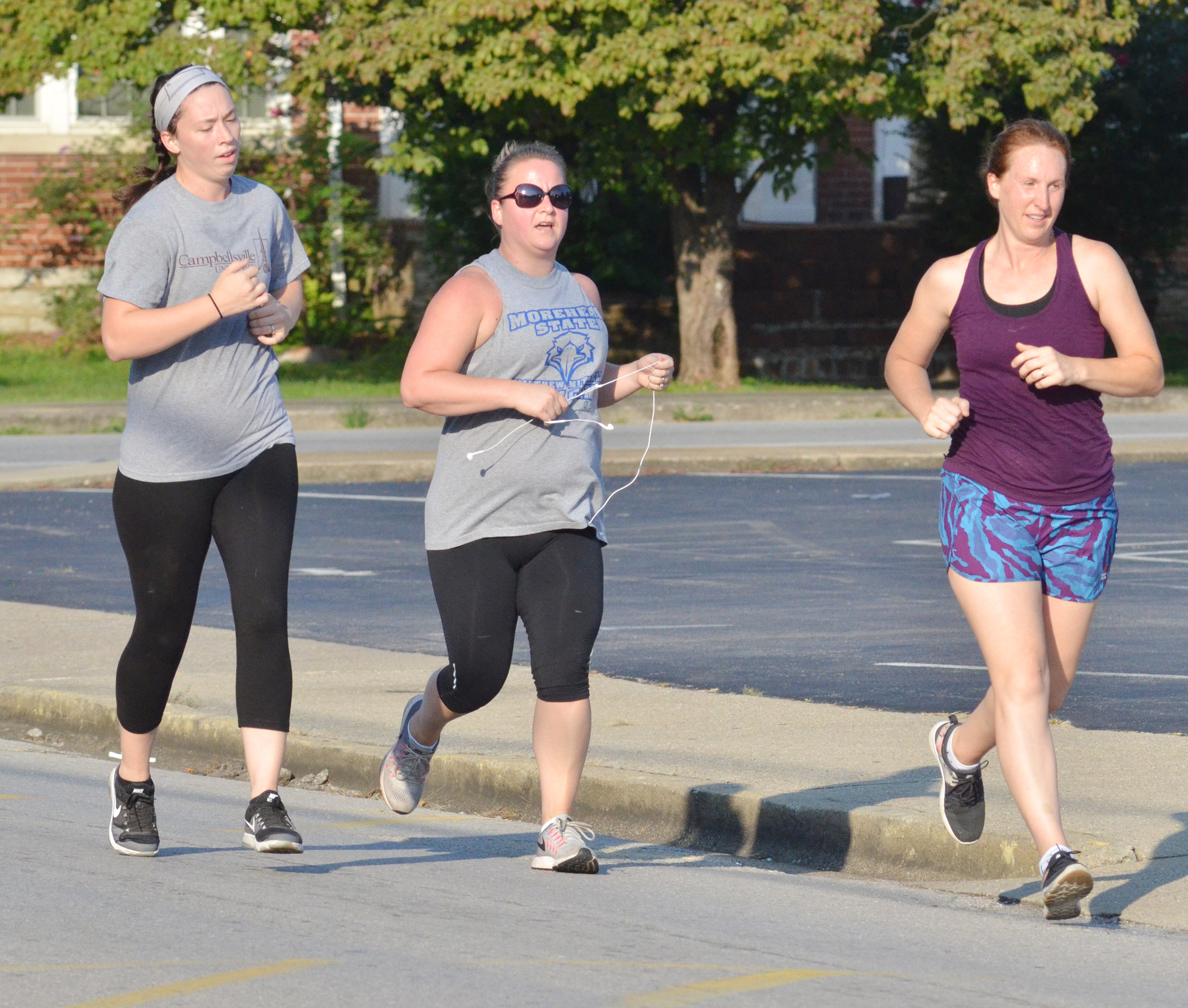 Campbellsville Middle School teacher Katie Campbell, center, finishes the 5K race.