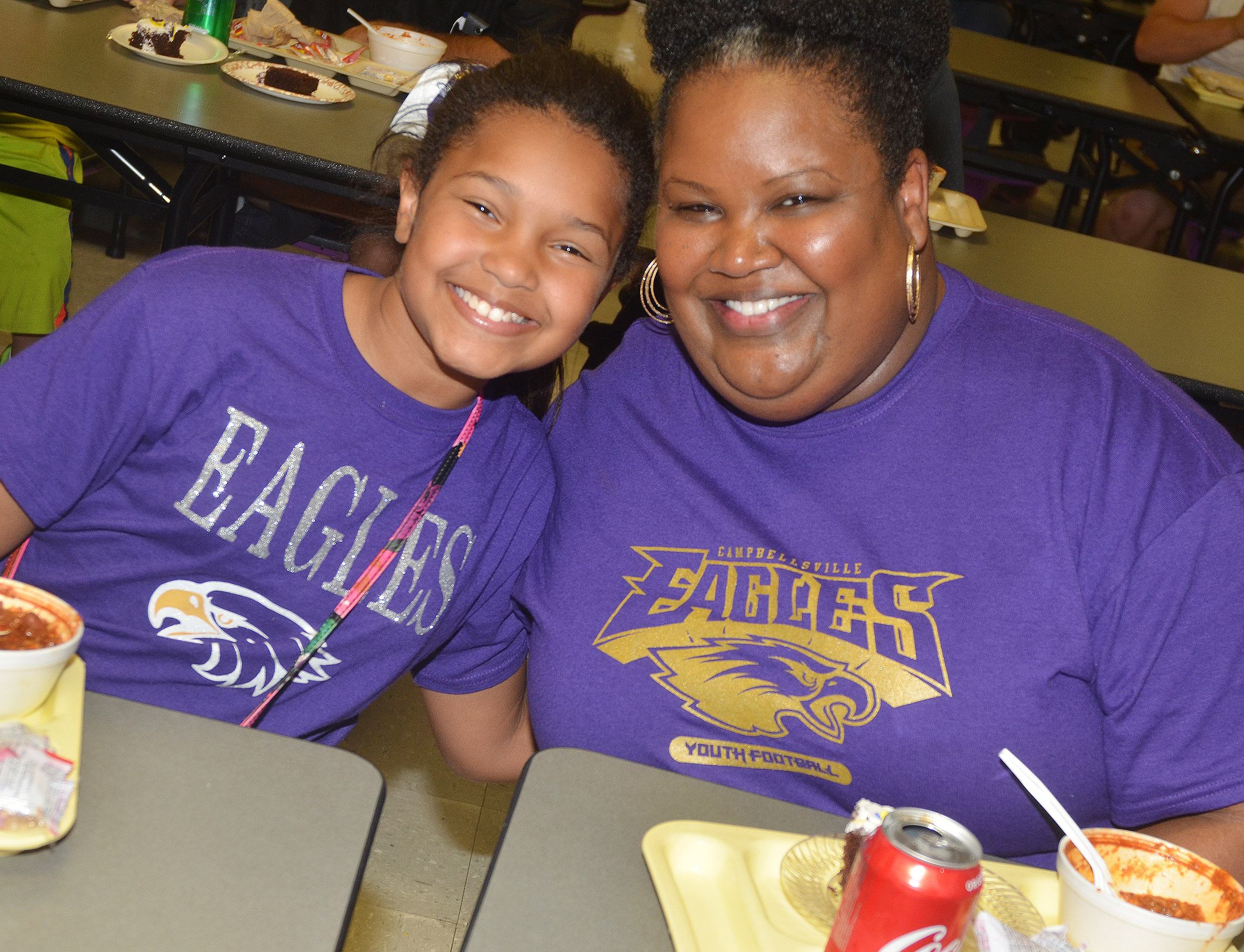 CES fifth-grader Jaclyn Jackson and her mother, Chanelle, smile as they enjoy chili.
