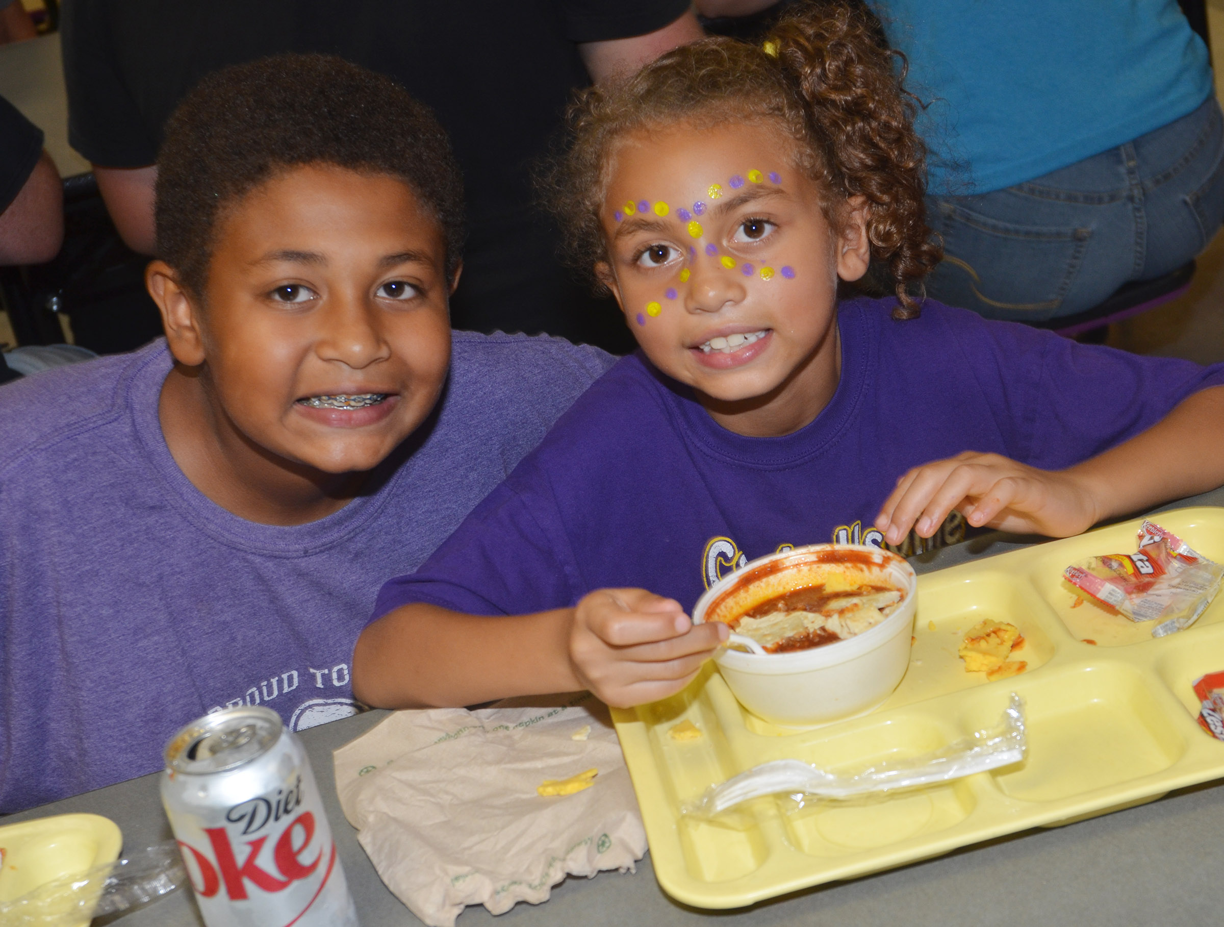 CMS seventh-grader Ronin Smith poses for a photo with his sister, CES second-grader Londyn Smith as they eat chili.