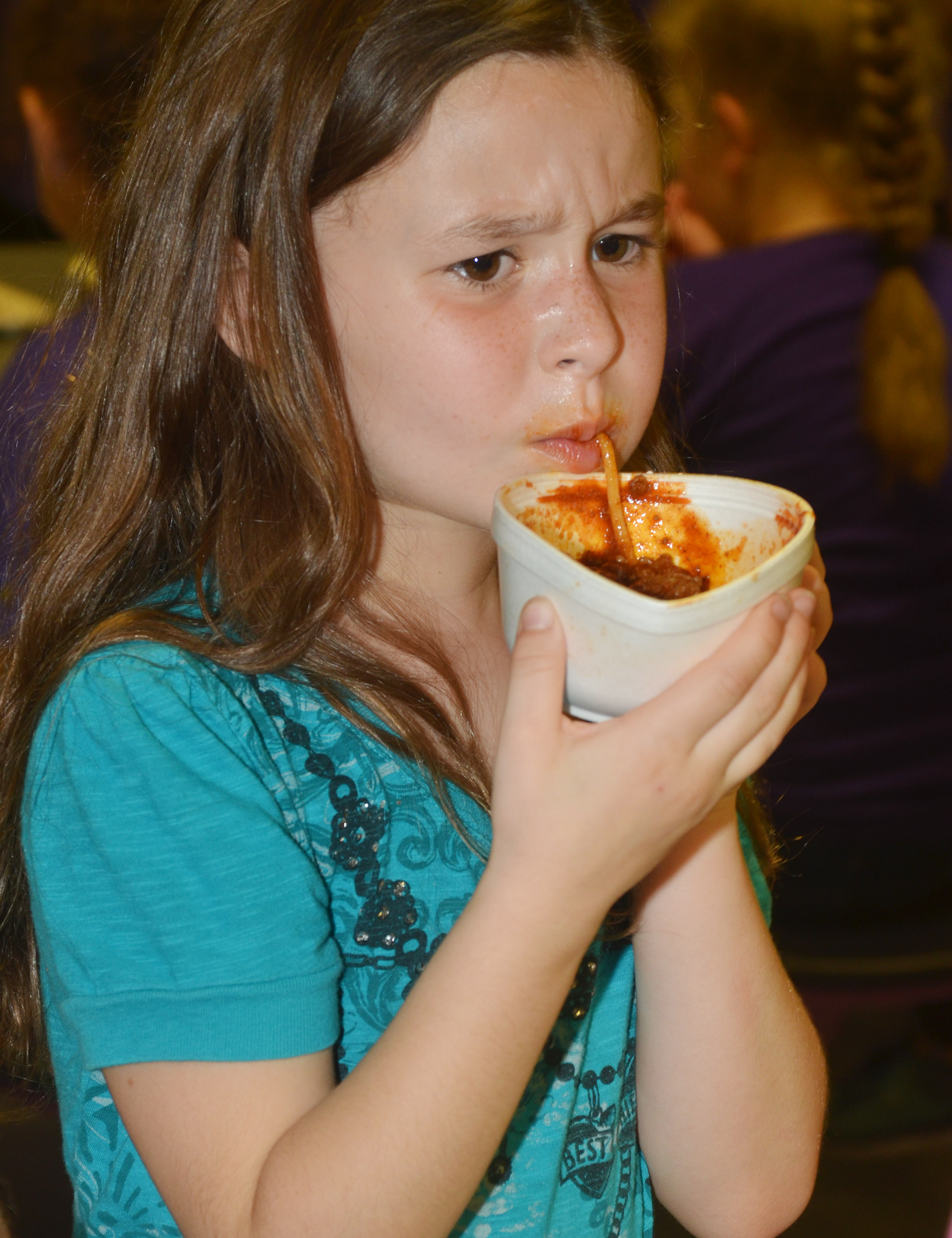 CES first-grader Stella Newcomb enjoys a bowl of chili.