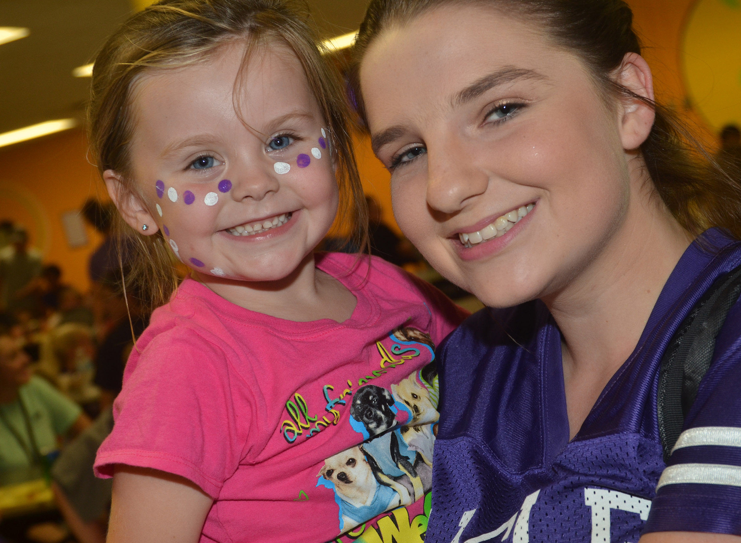 CHS sophomore Sydney Wilson holds CES preschool student Tori Clark at the chili supper.