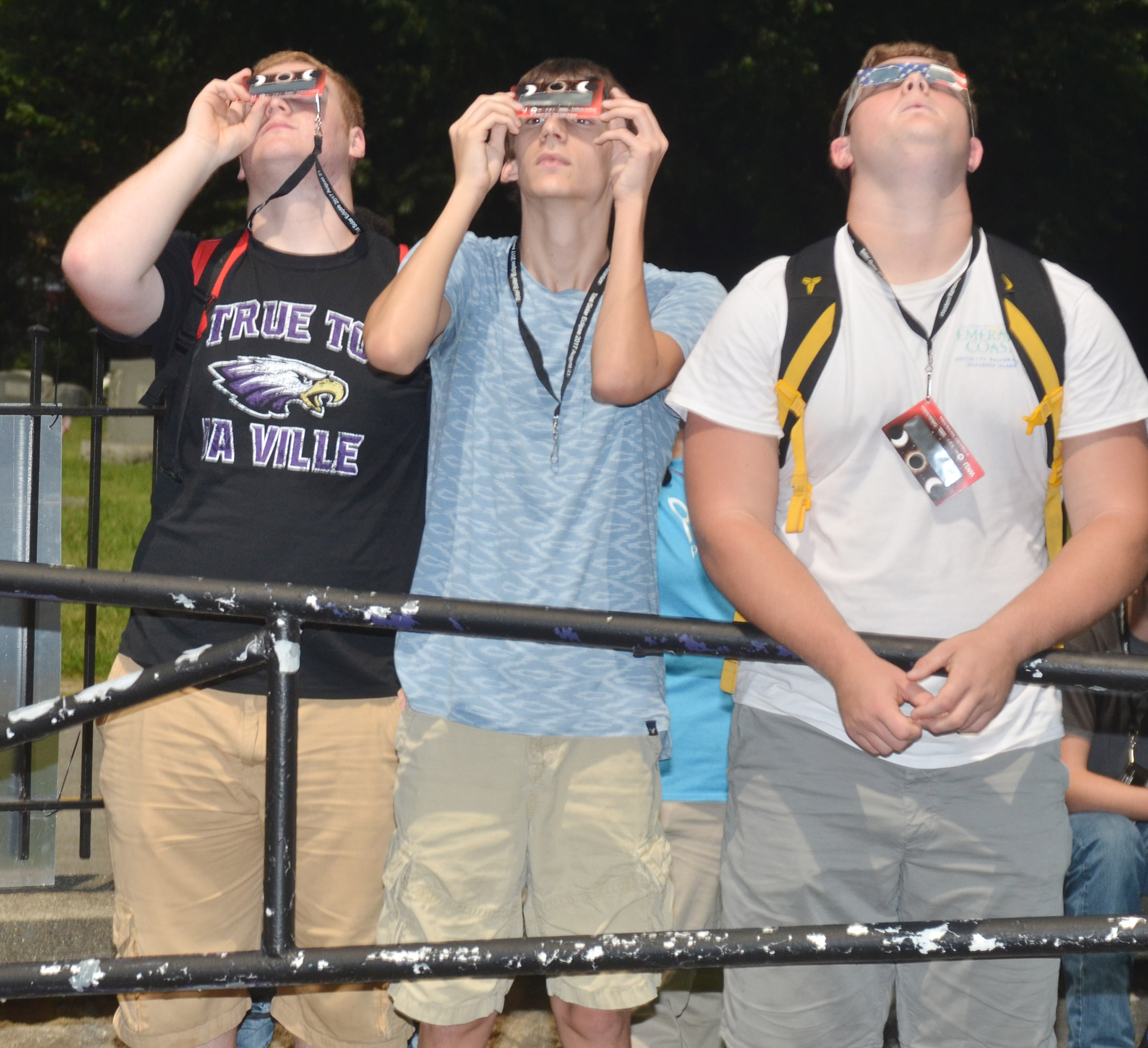 From left, CHS juniors Spencer Swafford, Ian McAninch and Lane Bottoms view the eclipse.