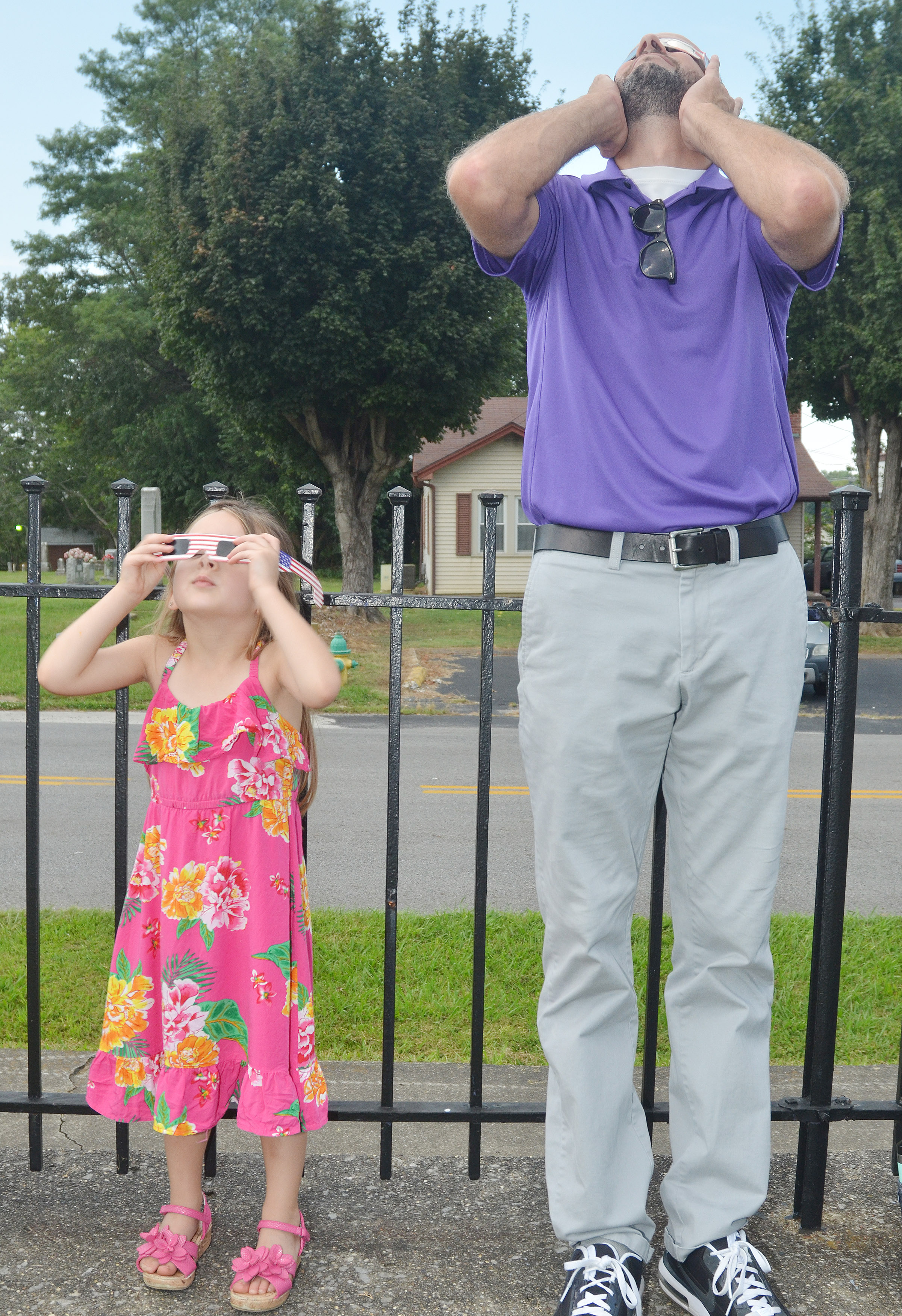 CHS teacher Ben Davis views the eclipse with his daughter, Lylah, who attends preschool at CES.