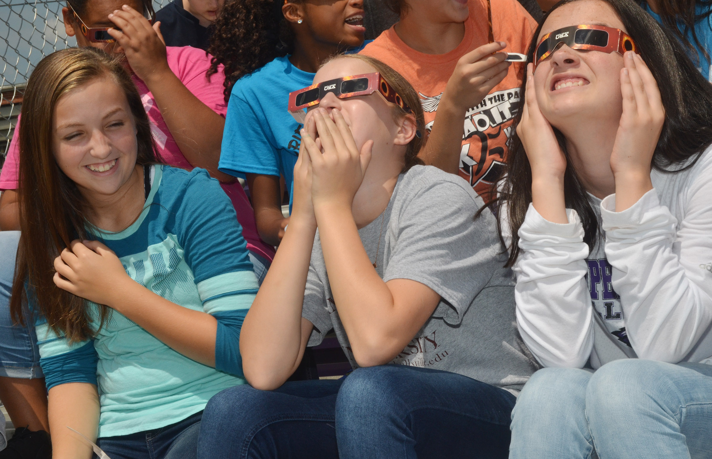 From left, CMS eighth-graders Lainey Watson, Rylee Petett and Sarah Adkins watch the eclipse.