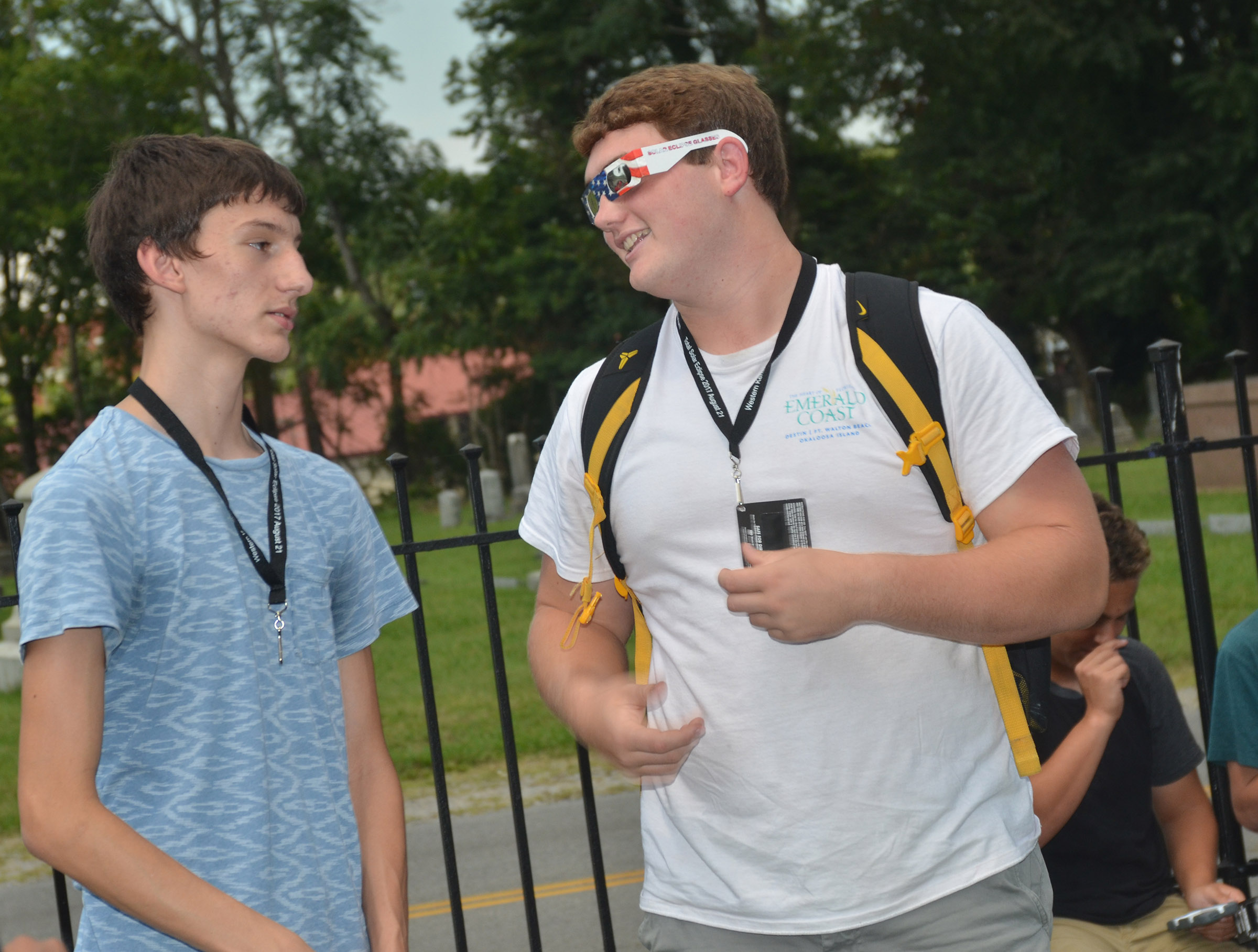 CHS juniors Ian McAninch, at left, and Lane Bottom talk as they view the eclipse.