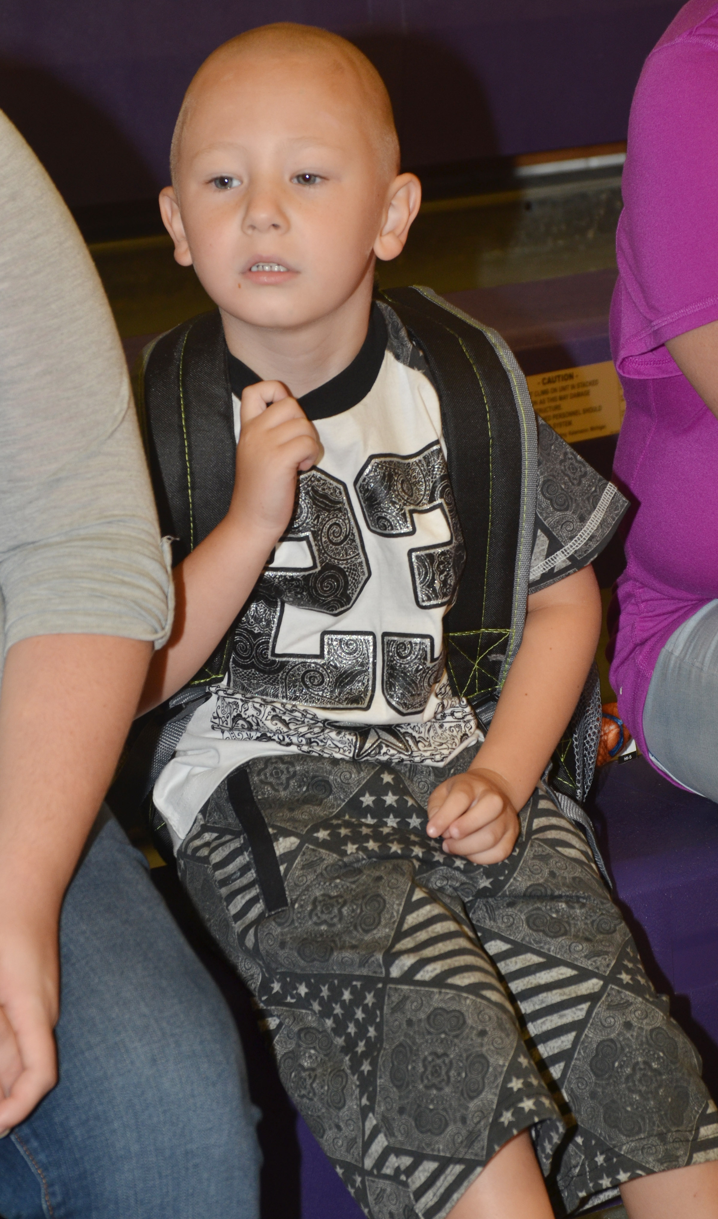 CES kindergartener Cameron Dean waits to go to his classroom.