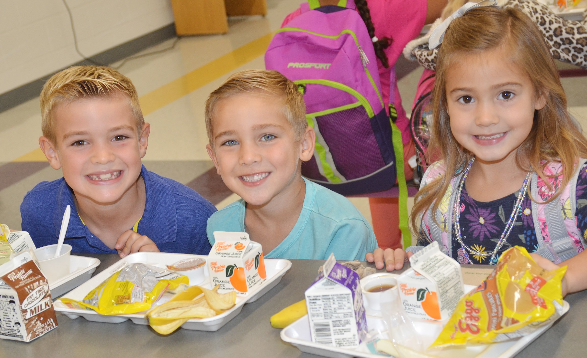 From left, second-grader Dax Gray has breakfast with his brother Dane and sister Blakely on their first day of kindergarten.