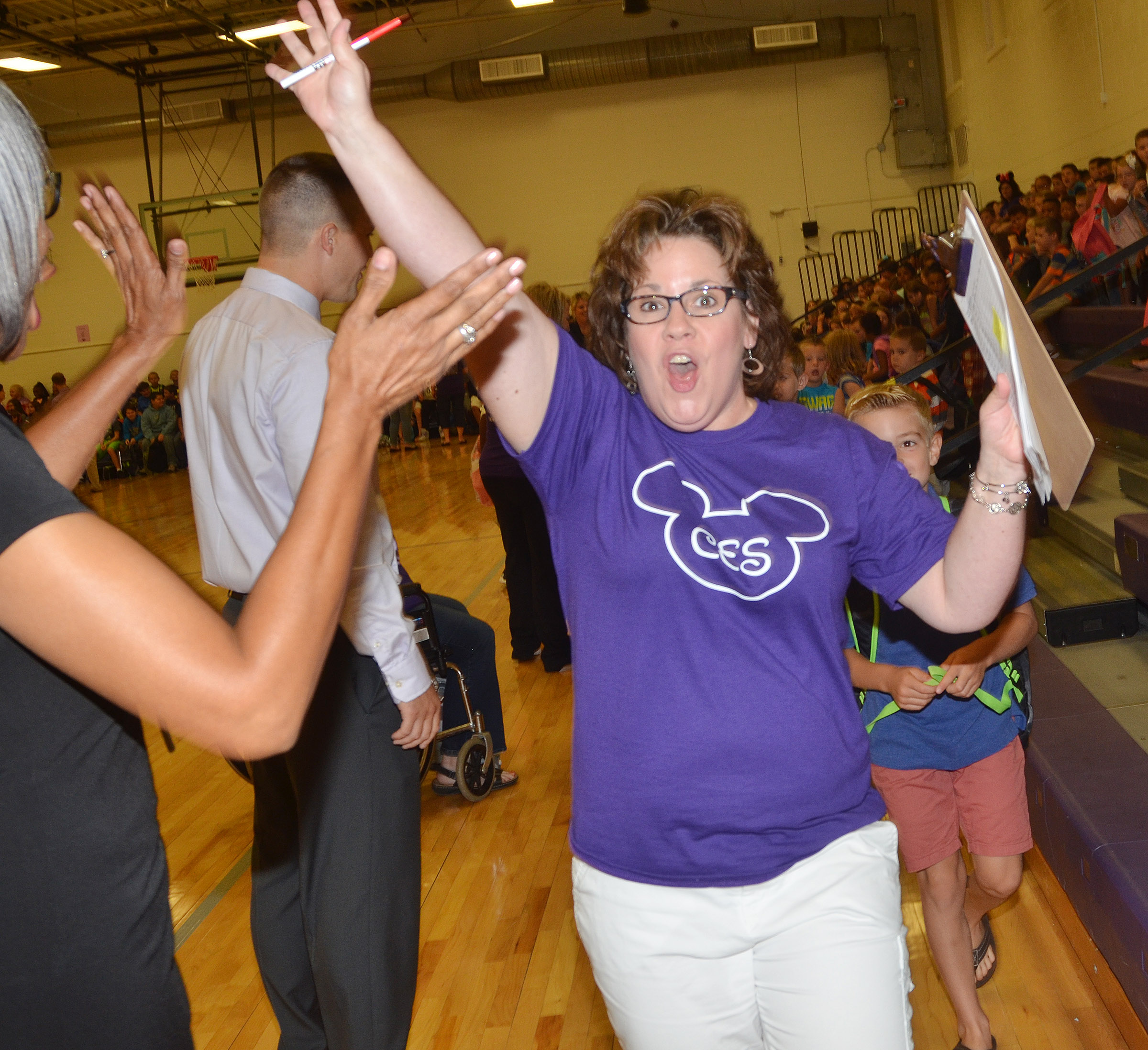 CES second-grader Tracey Rinehart celebrates the first day of school with Assistant Principal Doretha Sanders.