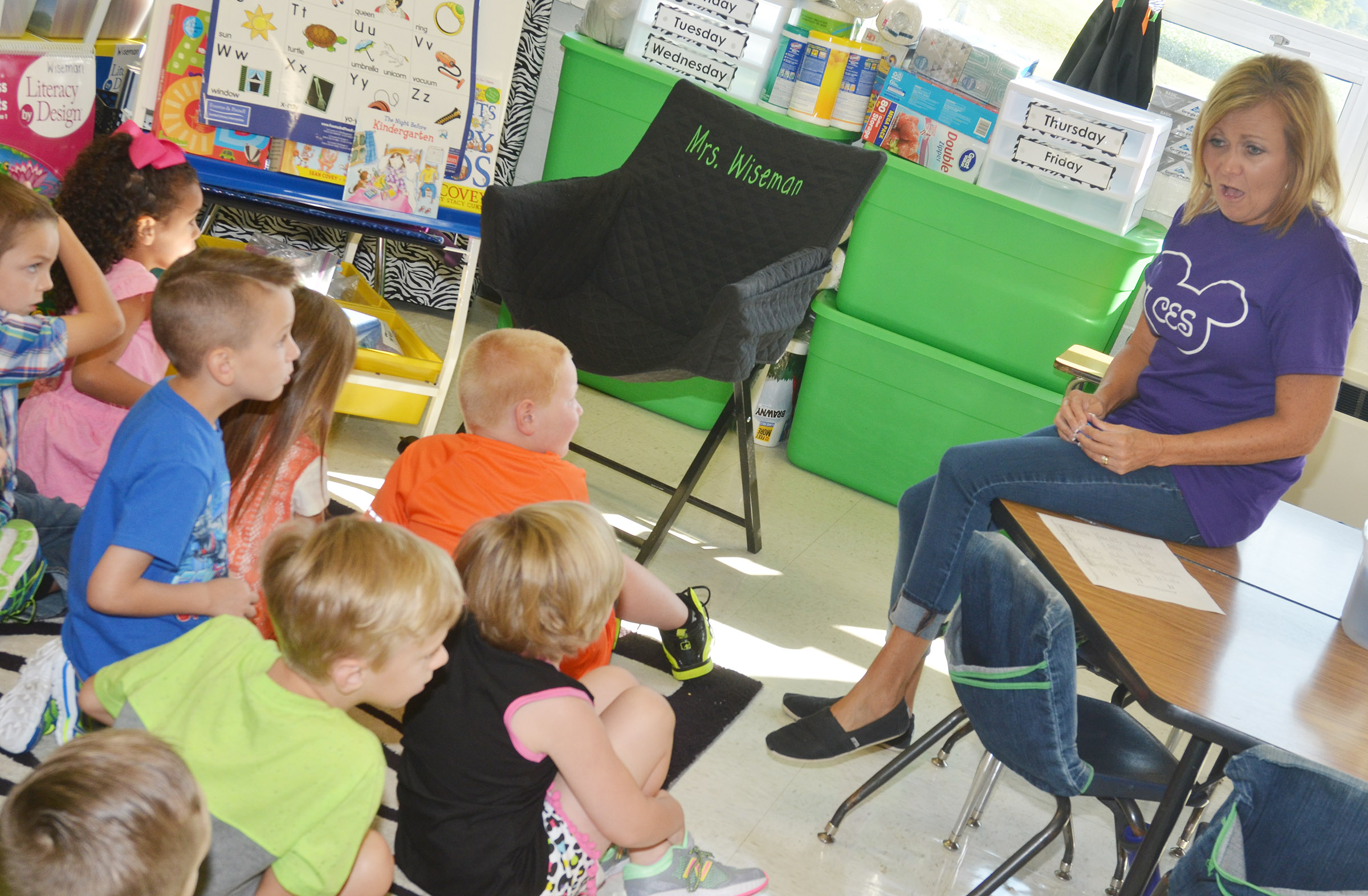 CES kindergarten teacher Lisa Wiseman talks with her students.