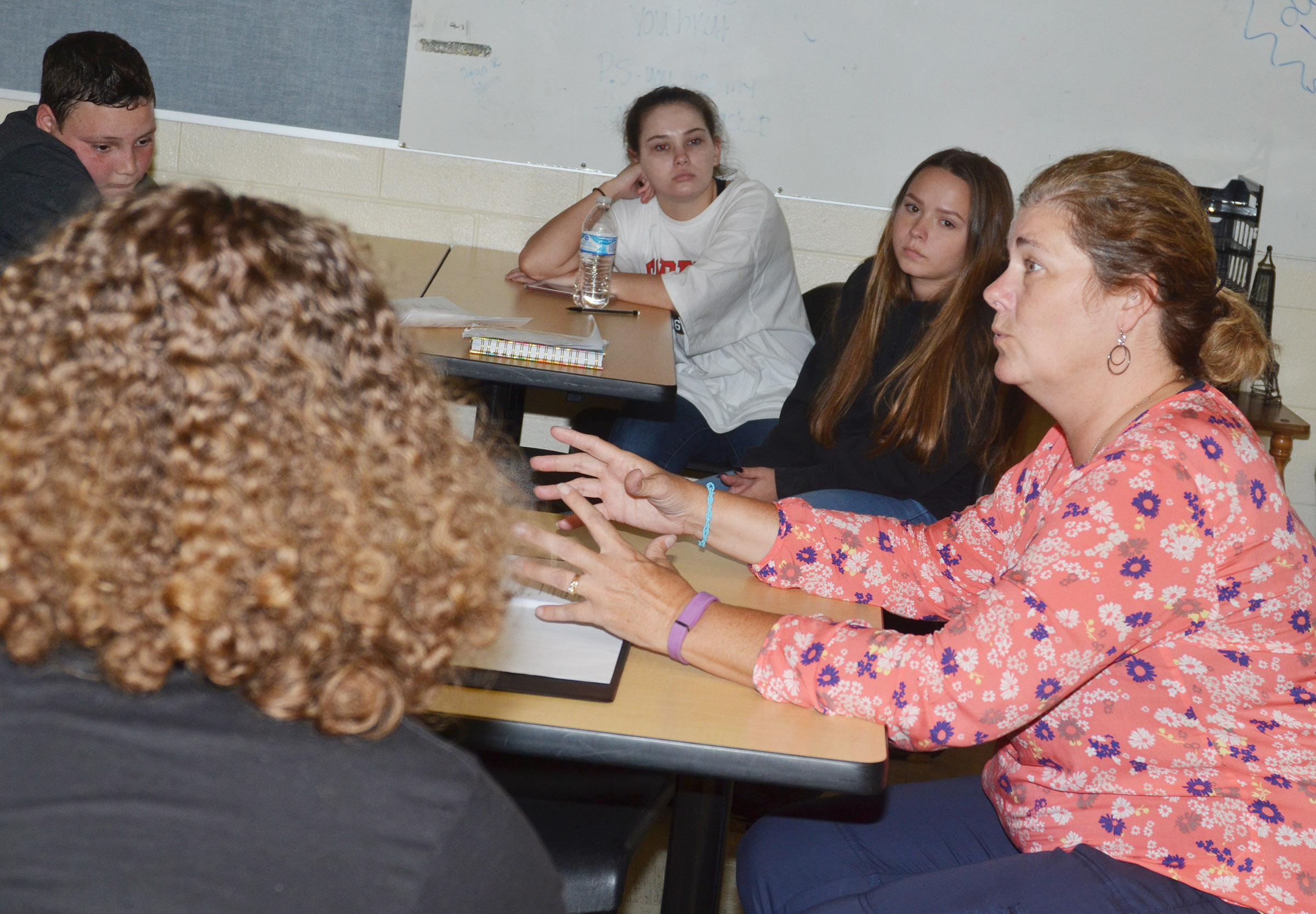 CHS teacher Tammy Wilson talks to her yearbook students.