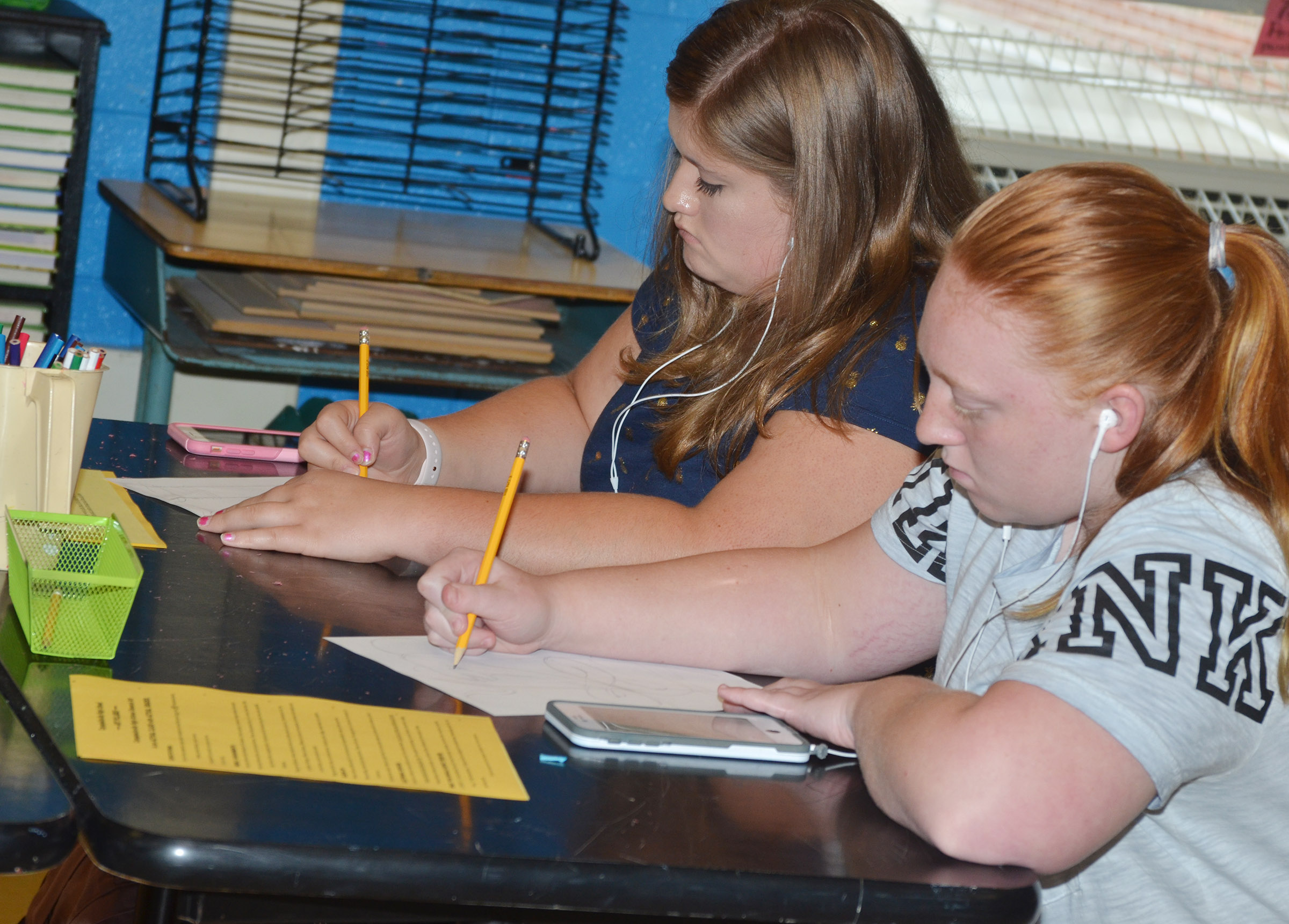 CHS sophomores Aleah Knifley, at left, and Haleigh Murphy draw in their art class.