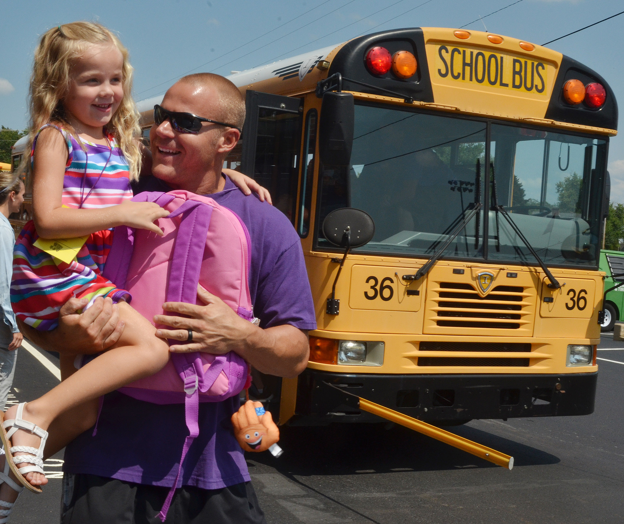 CES kindergartener Trinidy Gribbins runs to her dad, Robbie, after her first day of school.