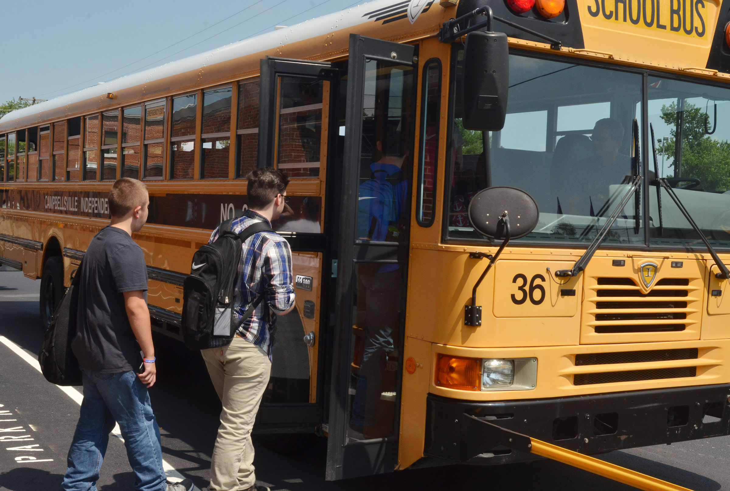 CIS students board the bus to go home after the first day of school.