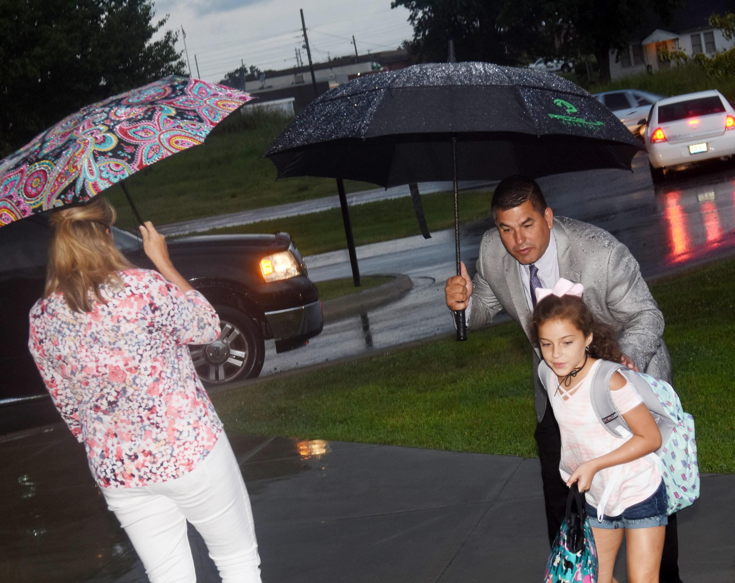 Campbellsville Independent Schools Superintendent Kirby Smith and his wife Andrea say goodbye to their daughter Karsyn as she begins her third-grade year at Campbellsville Elementary School.