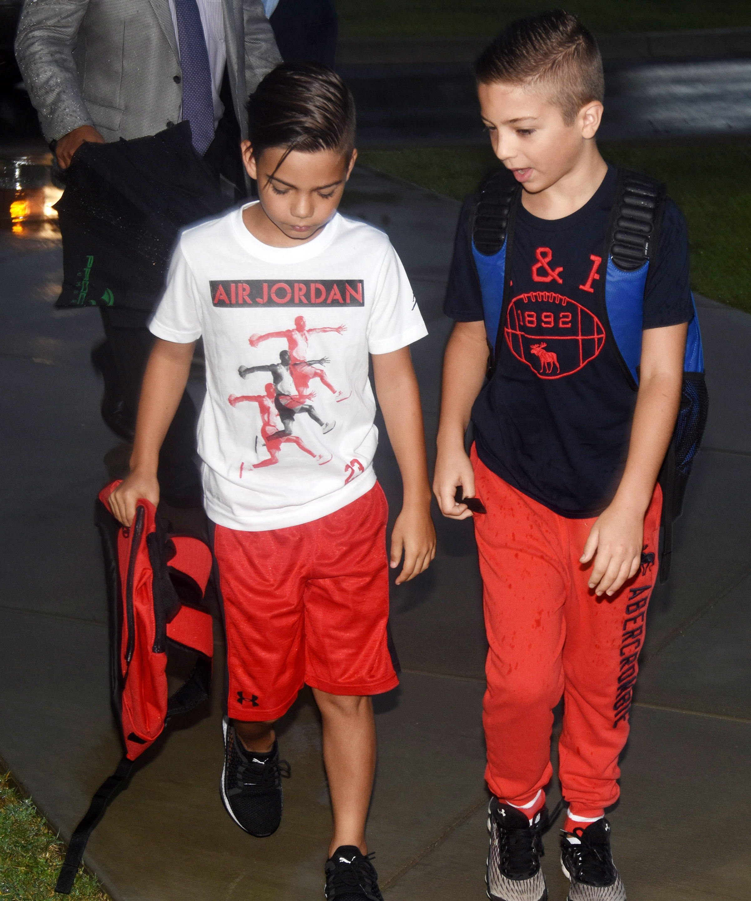 Campbellsville Elementary School fifth-graders Easton Williams, at left, and Carson Mills walk in for the first day of school.