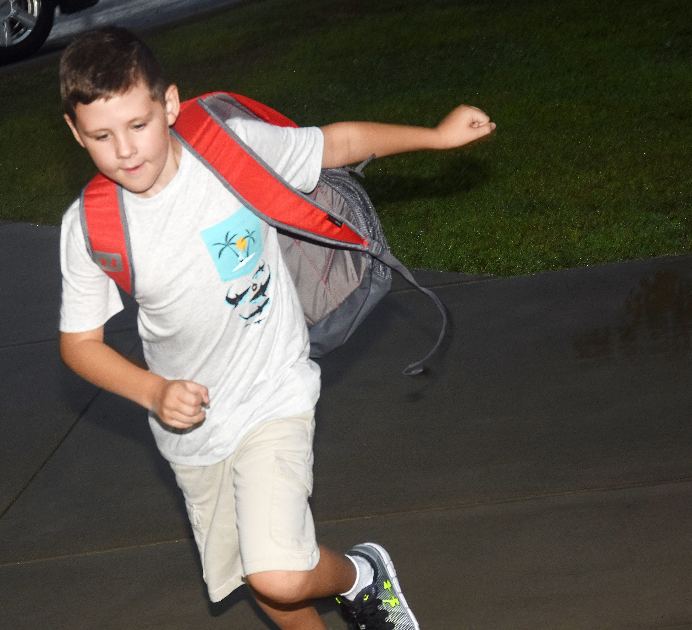 Campbellsville Elementary School fourth-grader Ryan Tungate skips to the door on the first day of school.