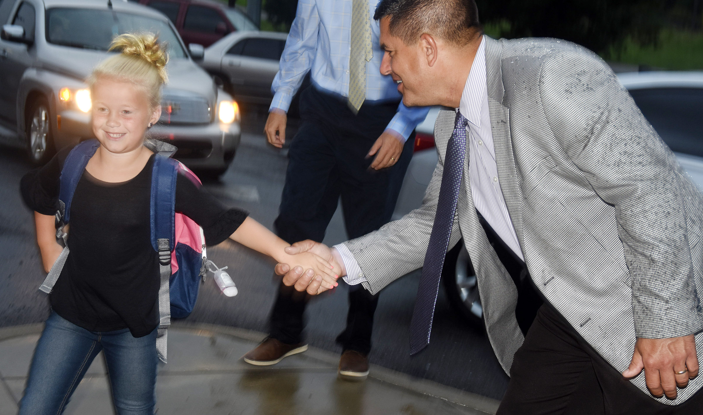 Campbellsville Independent Schools Superintendent Kirby Smith welcomes second-grader Lillie Judd to Campbellsville Elementary School.