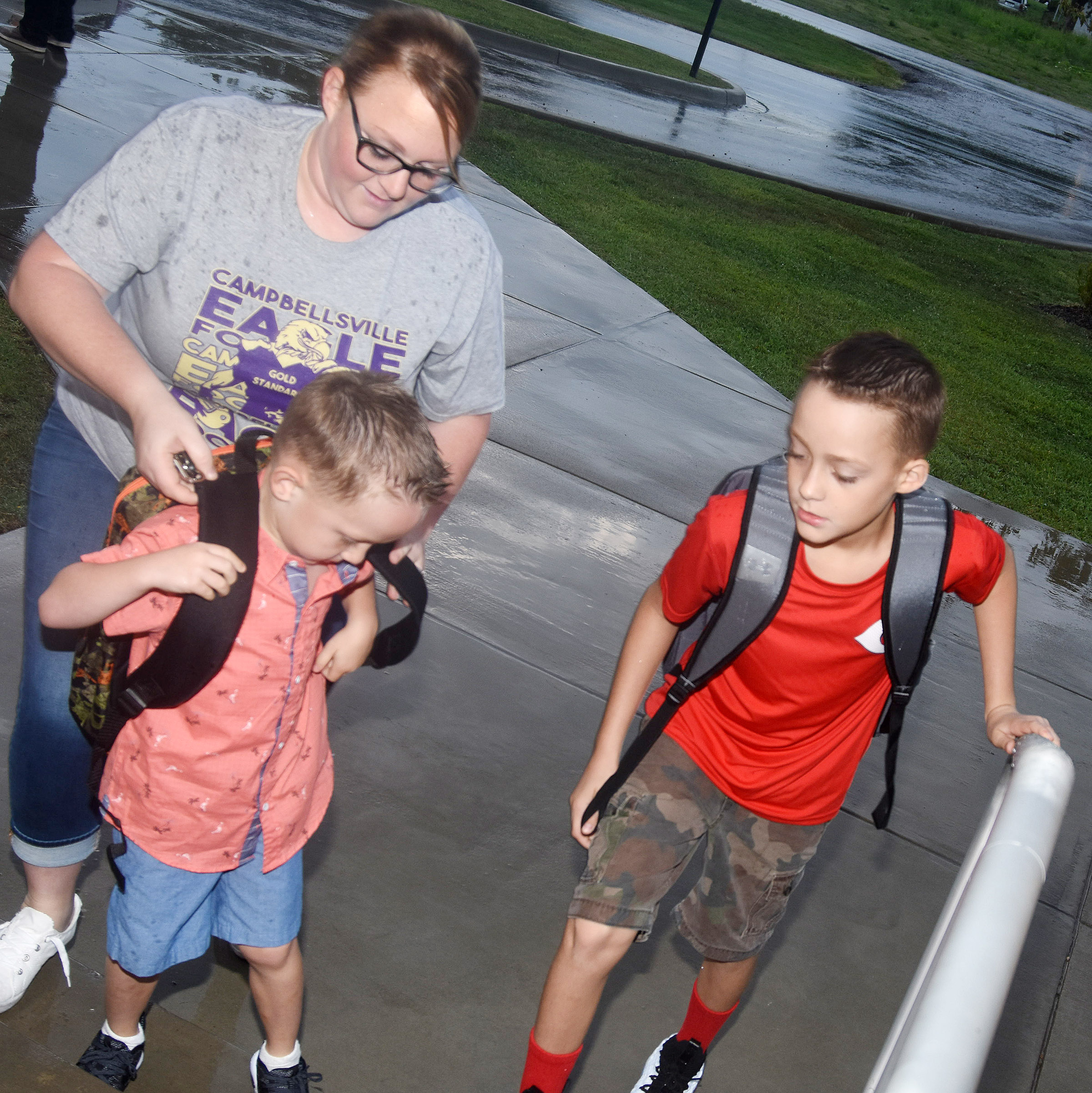 Madelyn Wise helps her sons, Connor, a kindergartener, and Caysen, a fifth-grader, as they start school at Campbellsville Elementary School.