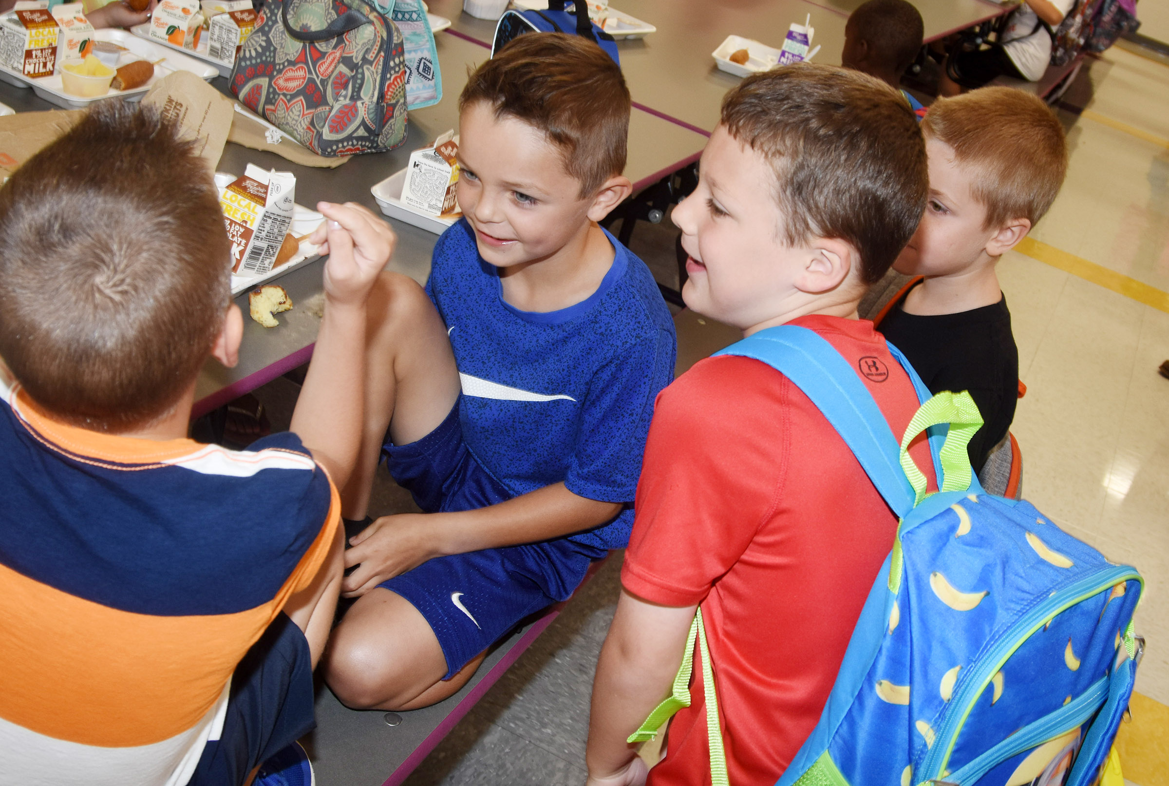 From left, Campbellsville Elementary School first-graders Cash Davis, Hayden Goff, Kyler Wilson and Alex Newcomb talk as they eat breakfast before school.