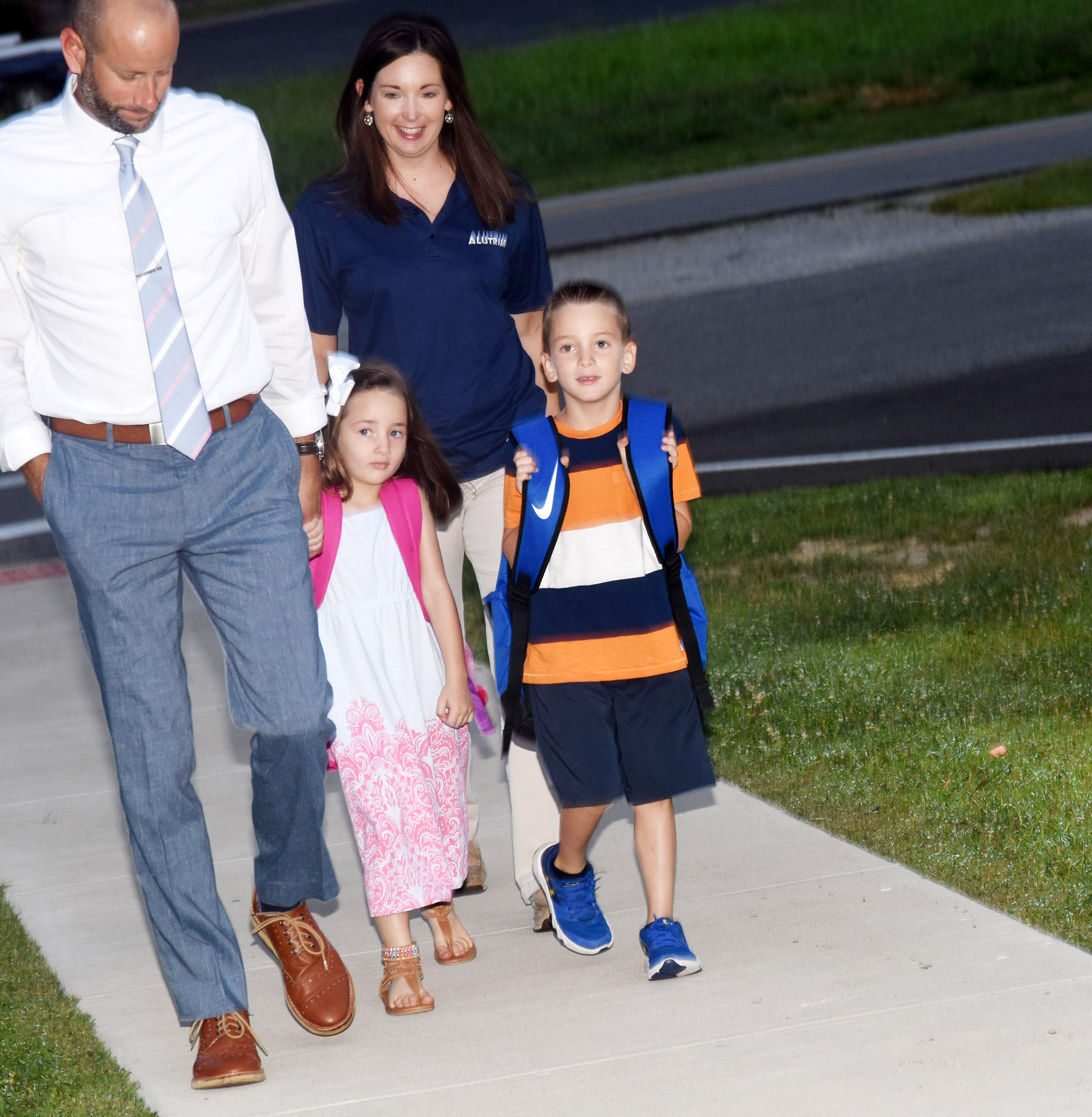 Campbellsville High School teacher Ben Davis and his wife Stephanie walk with their children as they start the school year at Campbellsville Elementary School. They are Cash, a first-grader, and Lylah, who started kindergarten.