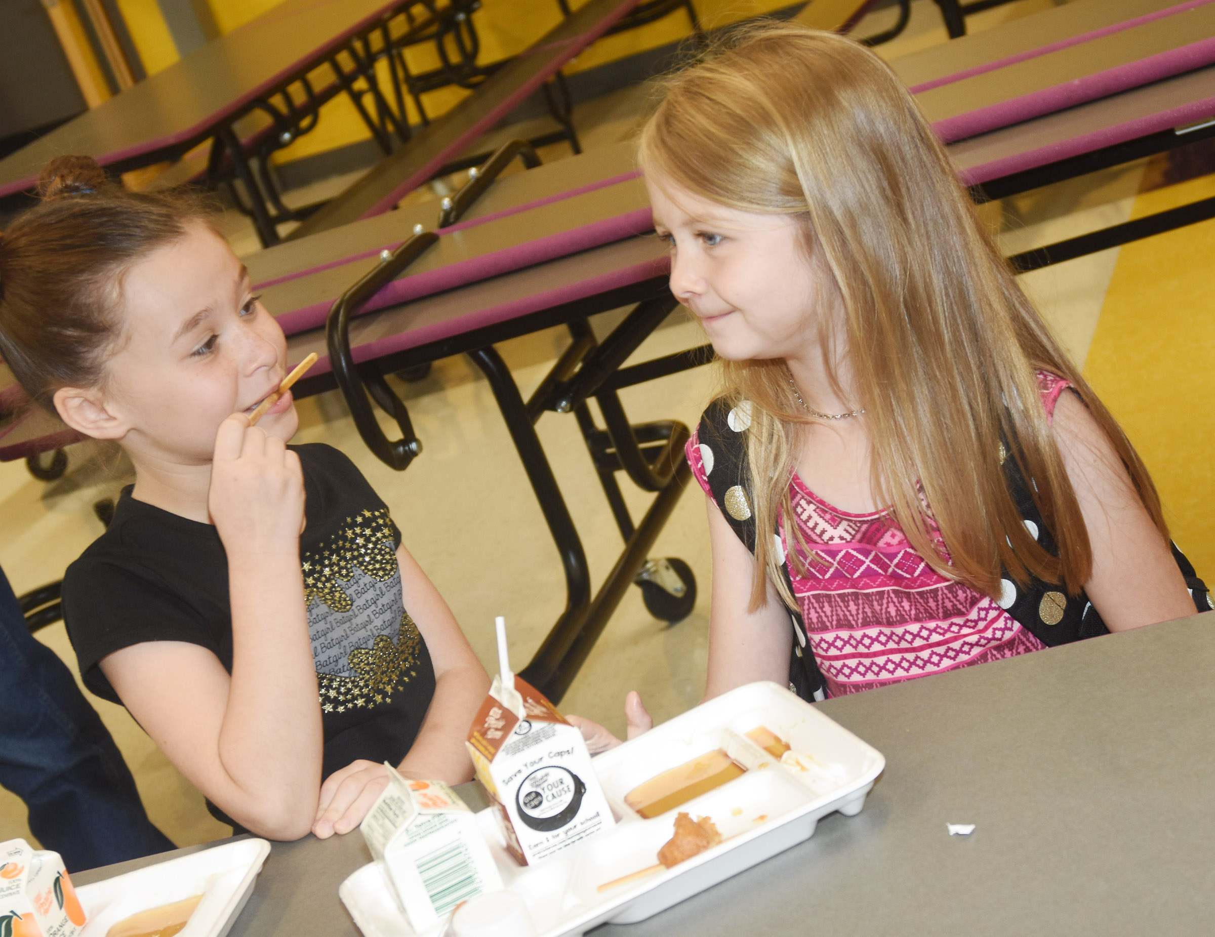 Campbellsville Elementary School second-graders Stella Newcomb, at left, and Jewell Brewster talk as they enjoy breakfast before school.