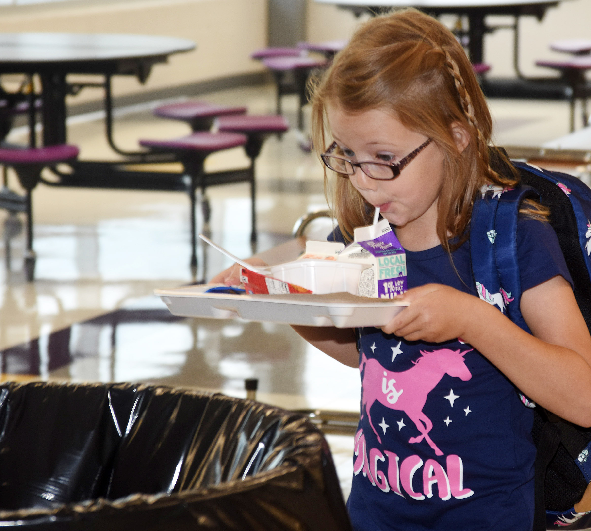 Campbellsville Elementary School first-grader Emmaline Vespie takes a final sip of milk before going to class.