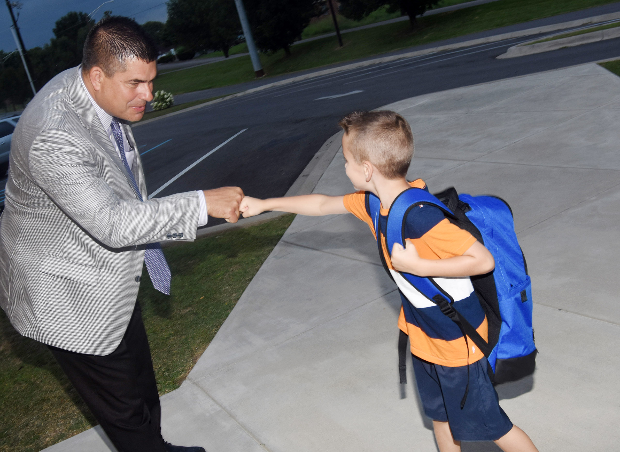 Campbellsville Independent Schools Superintendent Kirby Smith fist bumps first-grader Cash Davis as he walks in for the first day of school at Campbellsville Elementary School.