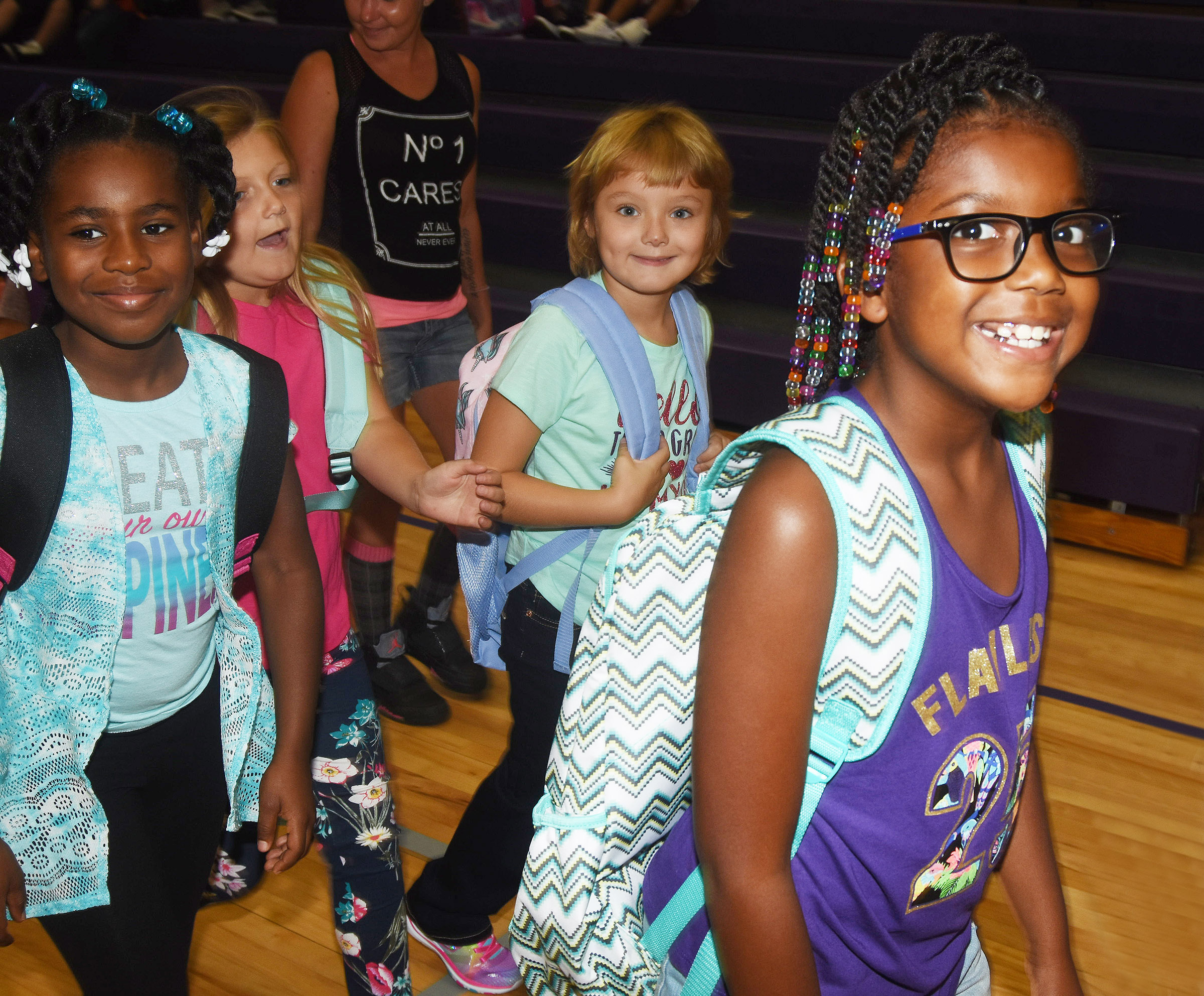 Campbellsville Elementary School third-grader Willow Griffin smiles with her classmates as they walk to class.