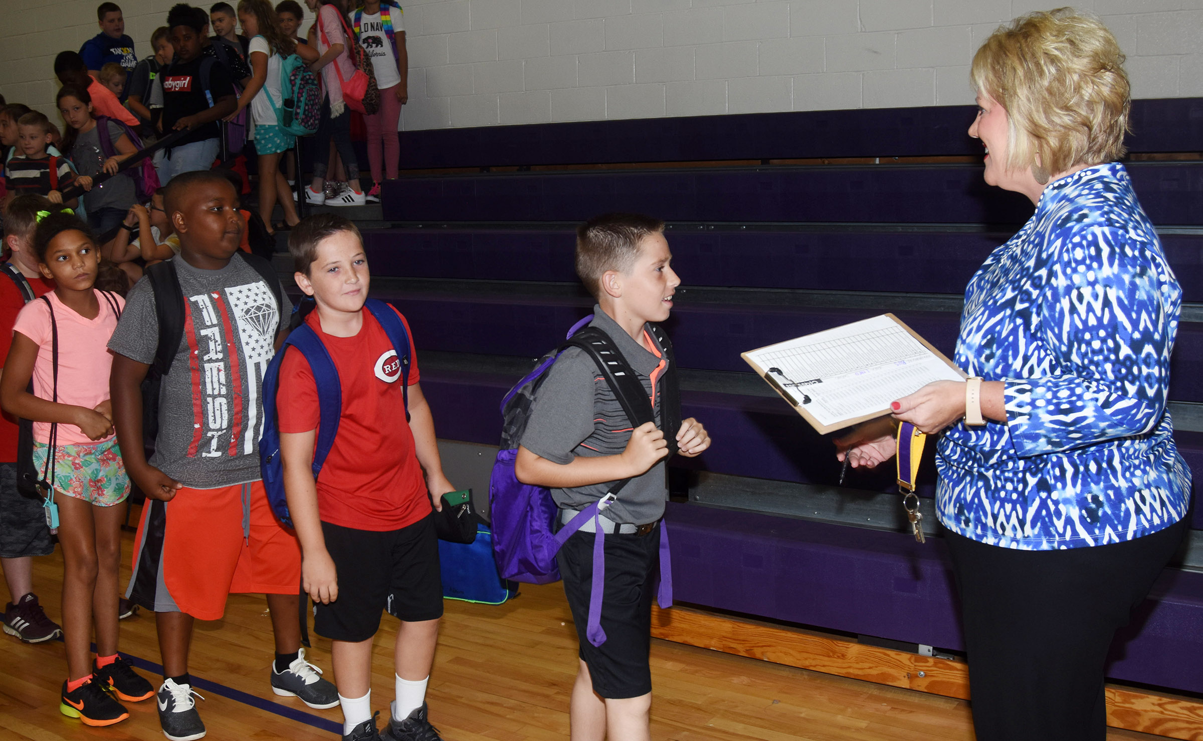 Campbellsville Elementary School fourth-grade teacher Kaye Agathen walks her students to their classroom.