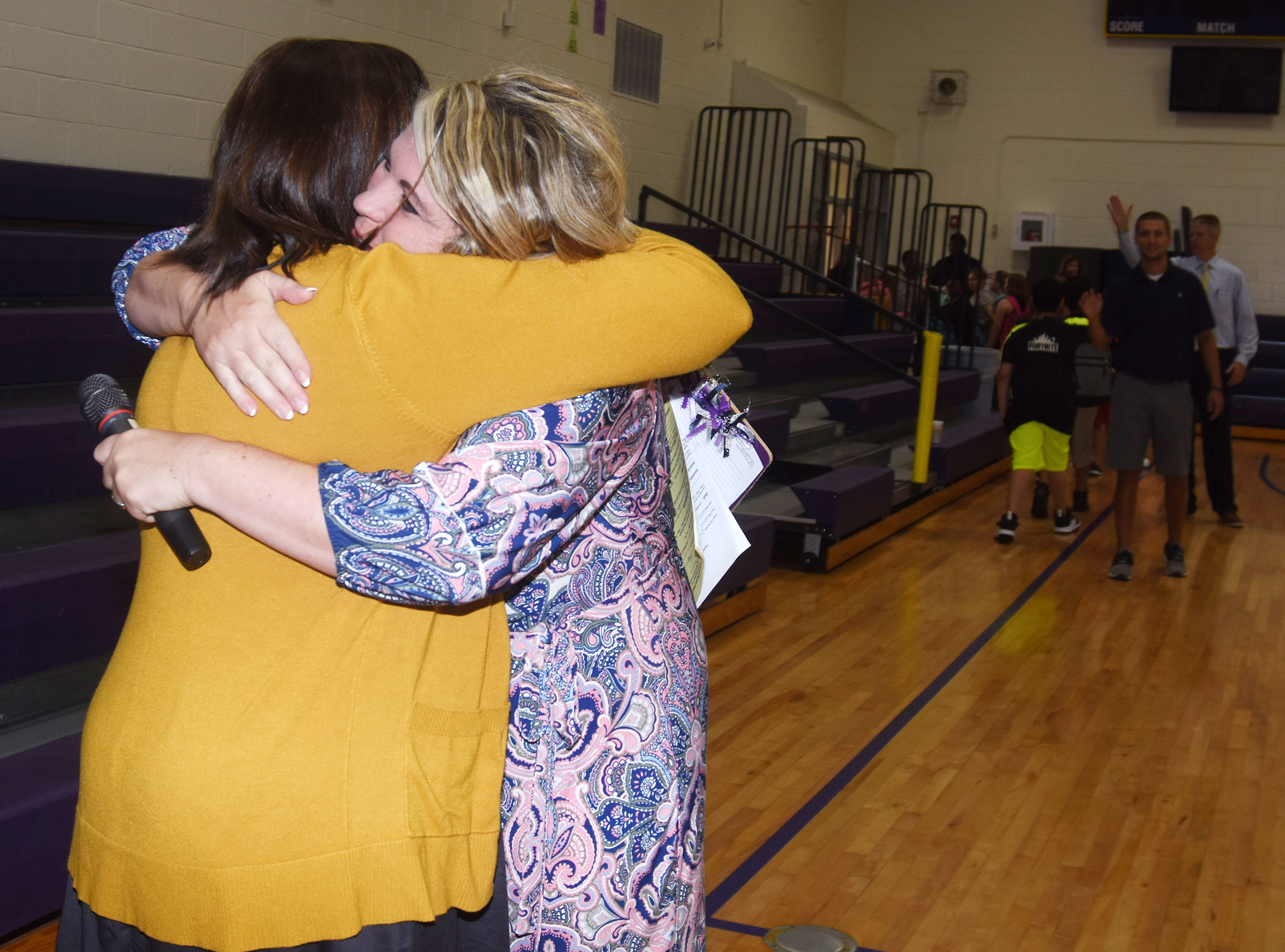 Campbellsville Elementary School Principal Elisha Rhodes hugs fifth-grade teacher Jessica Lile as the school day begins.