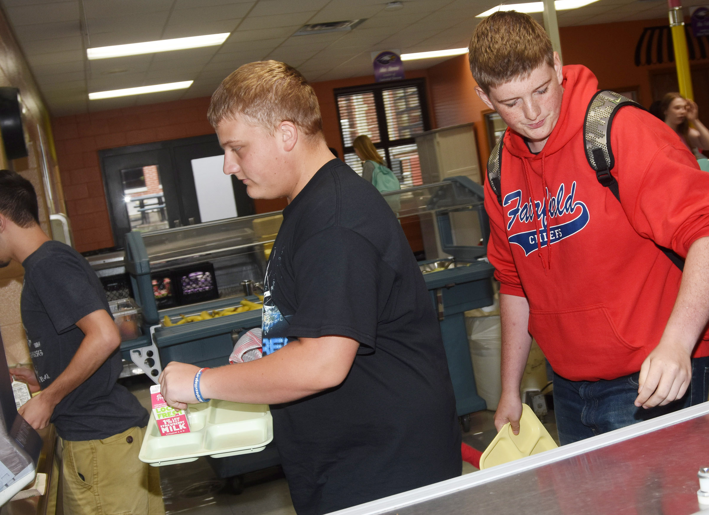 Campbellsville High School senior Quentin Skaggs gets a tray at lunch.