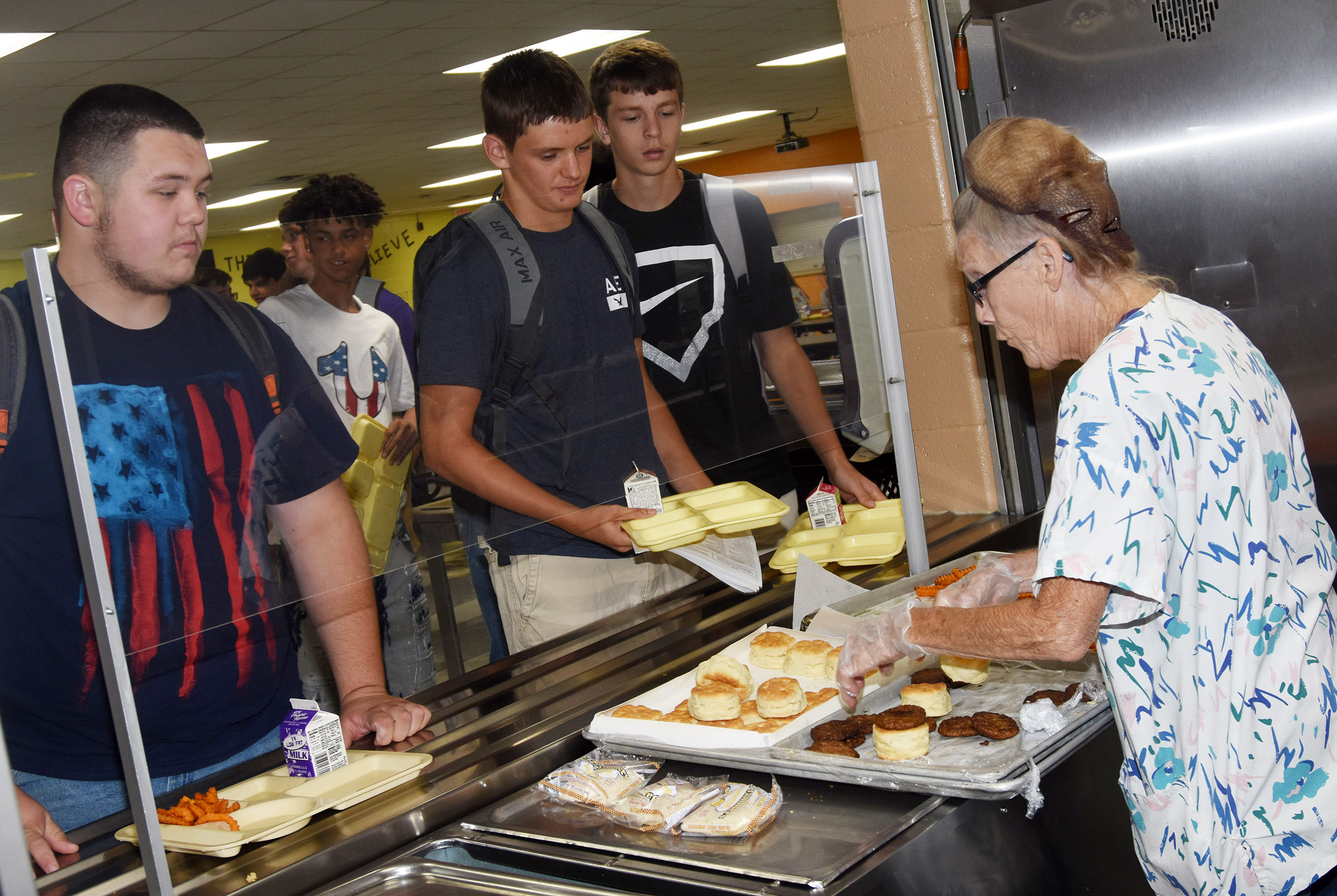 From left, Campbellsville High School senior Jorden Perkins and junior Blake Allen and Noah Hughes are served lunch.