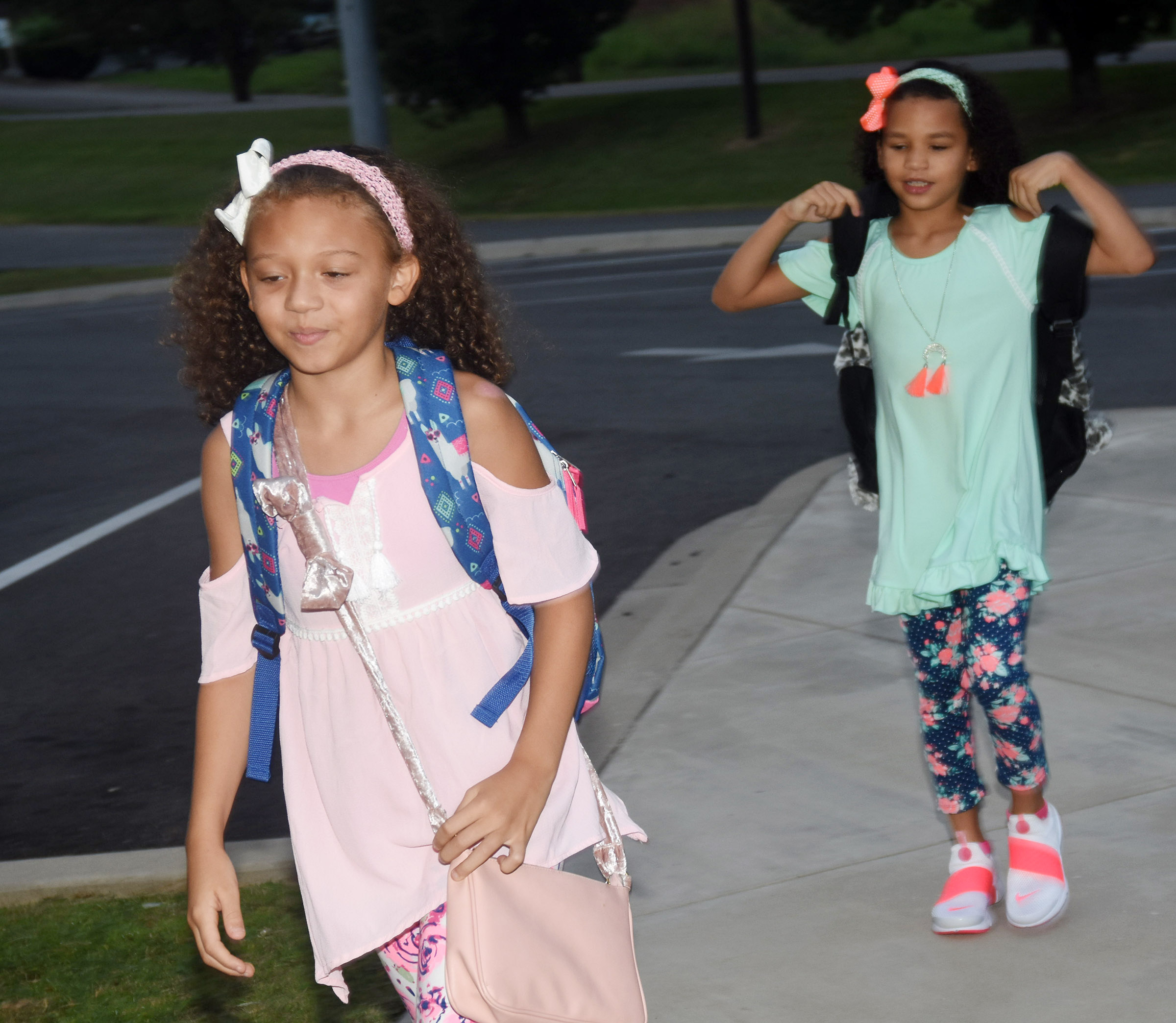 Campbellsville Elementary School fifth-grader Alicia Spaulding, in front, and her sister Aleeya, who is a second-grader, walk in for the first day of school.