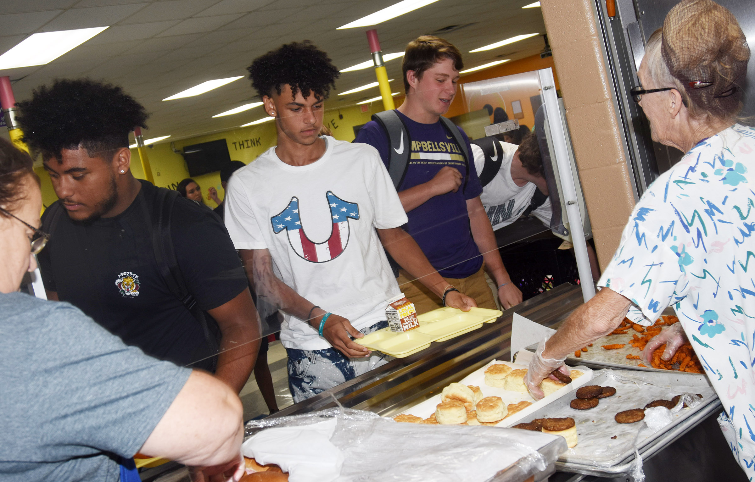 From left, Campbellsville High School junior Braden Paige, Mikael Vaught and Dillon Whitaker are served lunch.