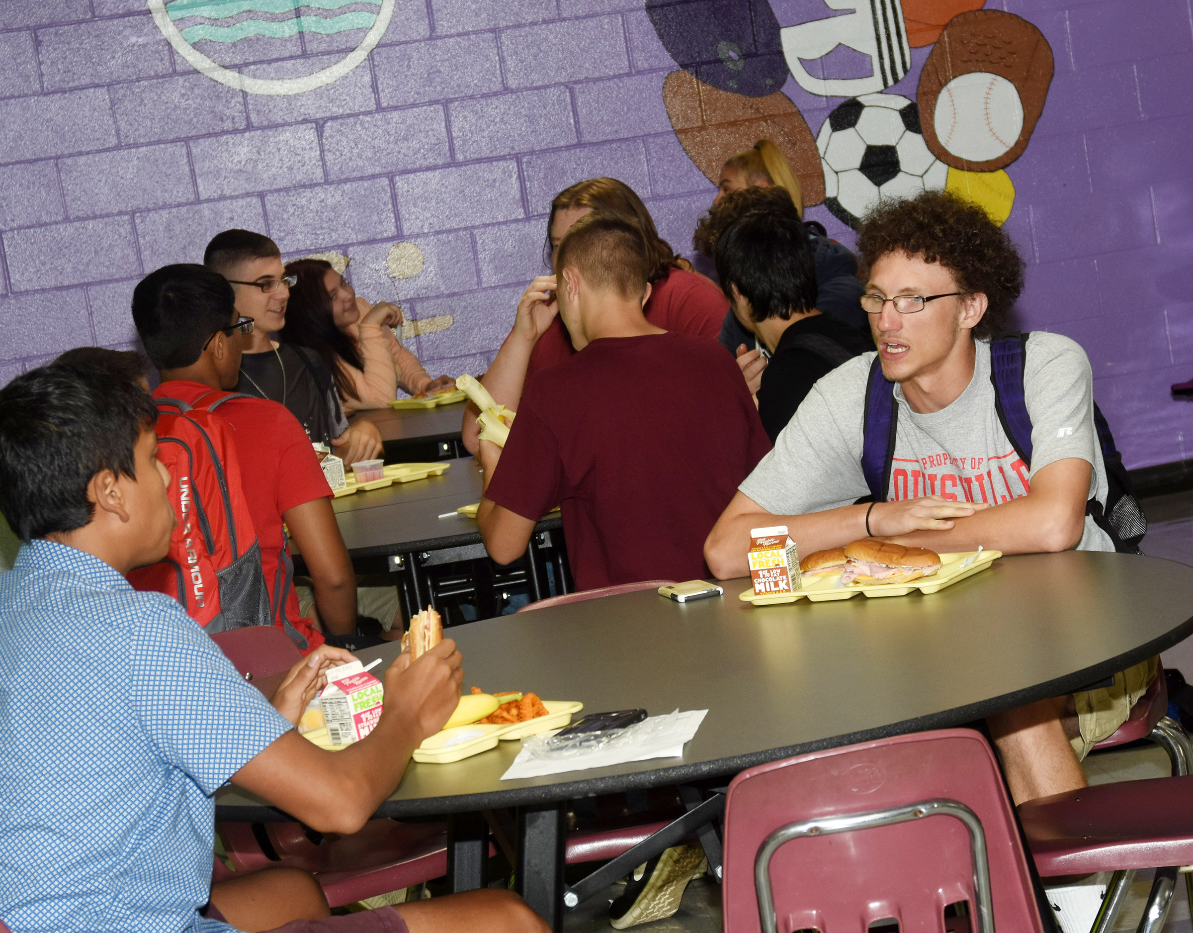 Campbellsville High School junior Brennon Wheeler talks with his classmates at lunch.