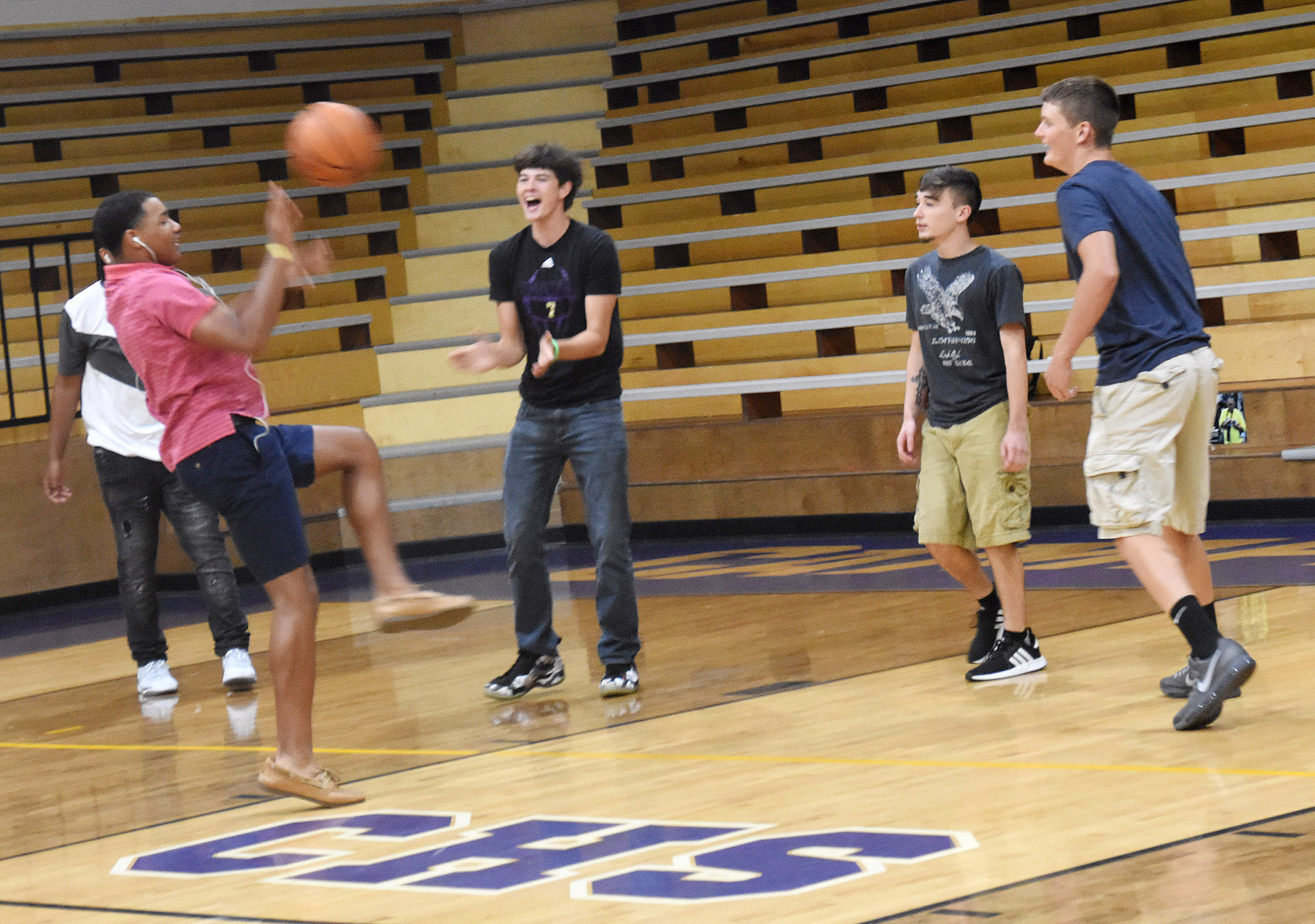 Campbellsville High School students play basketball during their lunch period.