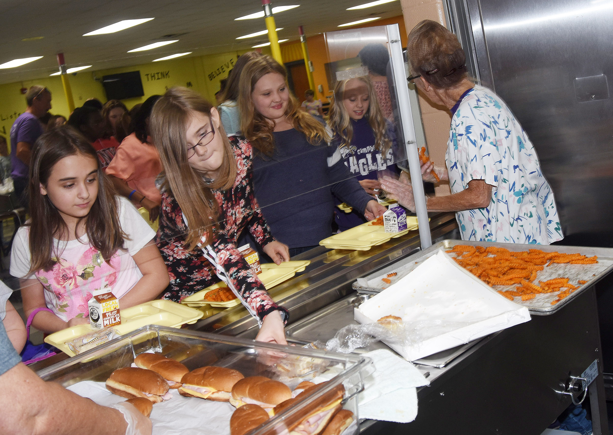 Campbellsville Middle School sixth-graders are served lunch.