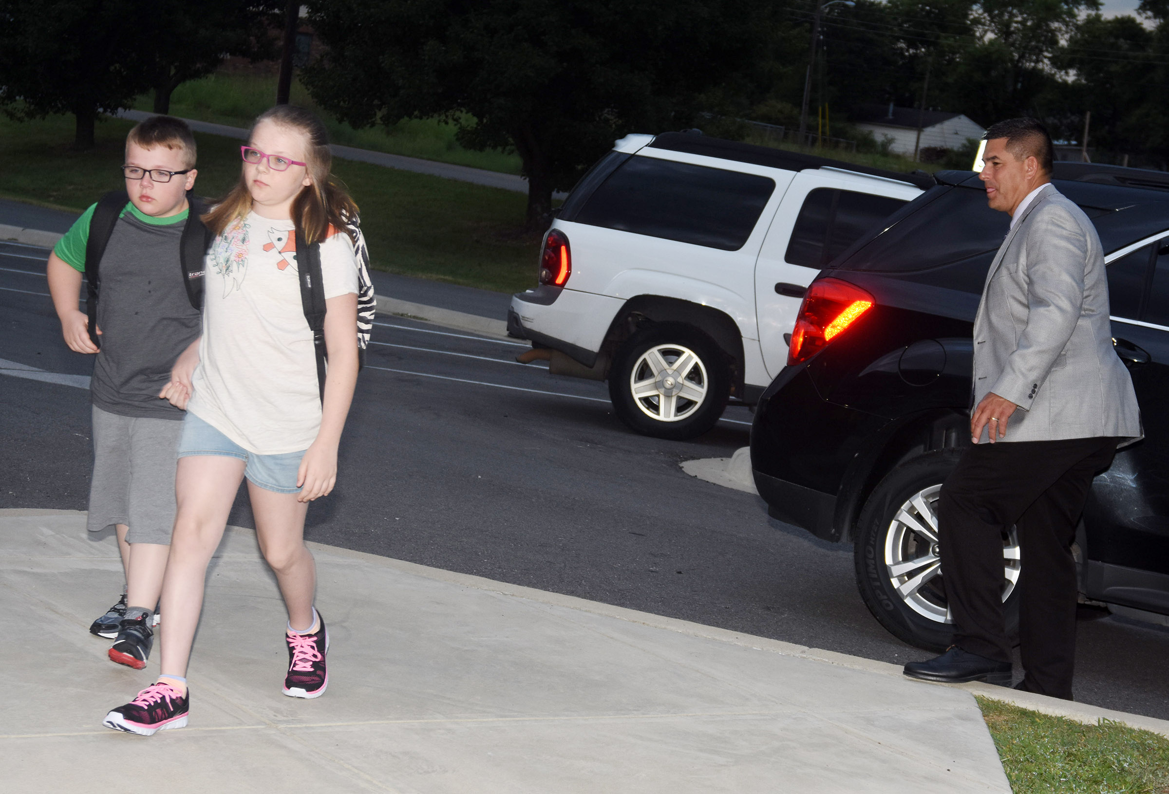 Campbellsville Elementary School fifth-grader Jaylen Clark holds her brother Hunter's hand as they walk in for the first day of school. Hunter is a third-grader at CES.