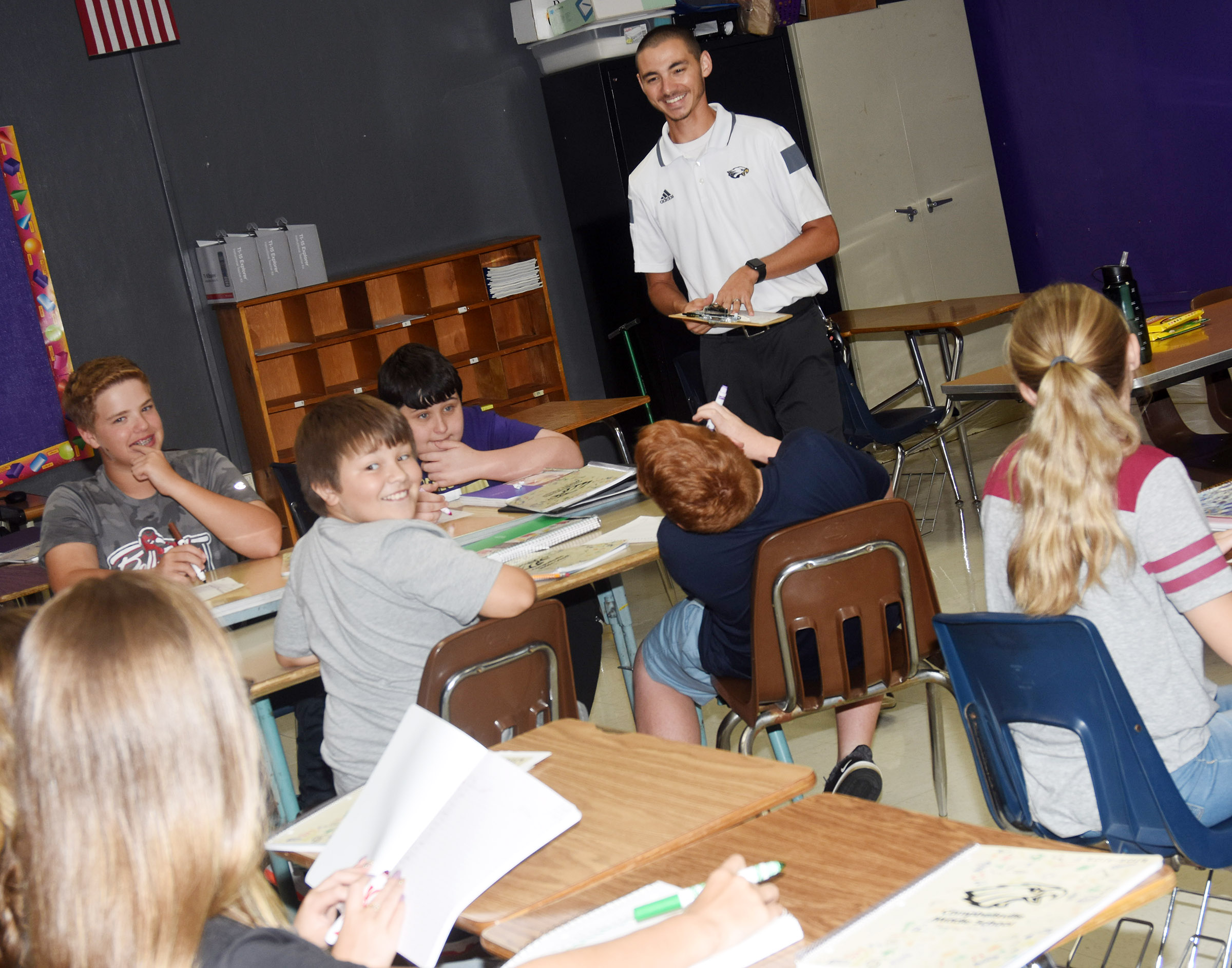 Campbellsville Middle School seventh-grade teacher Bradley Harris plays a game with his students to see how well they know each other.