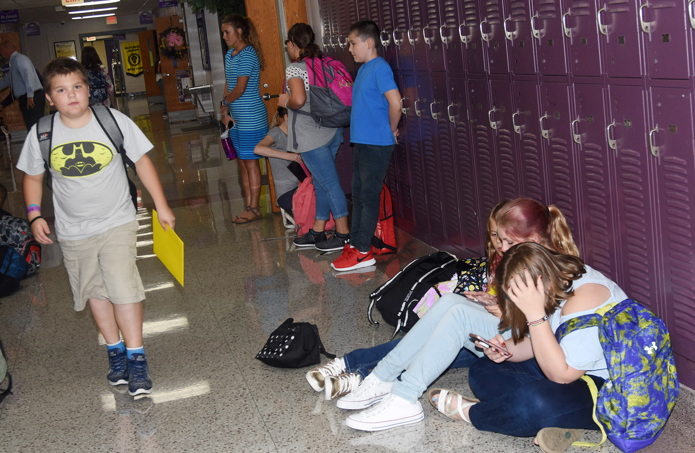 Campbellsville Middle School sixth-grader Logan England walks down the hallway as he and his classmates prepare to go home.