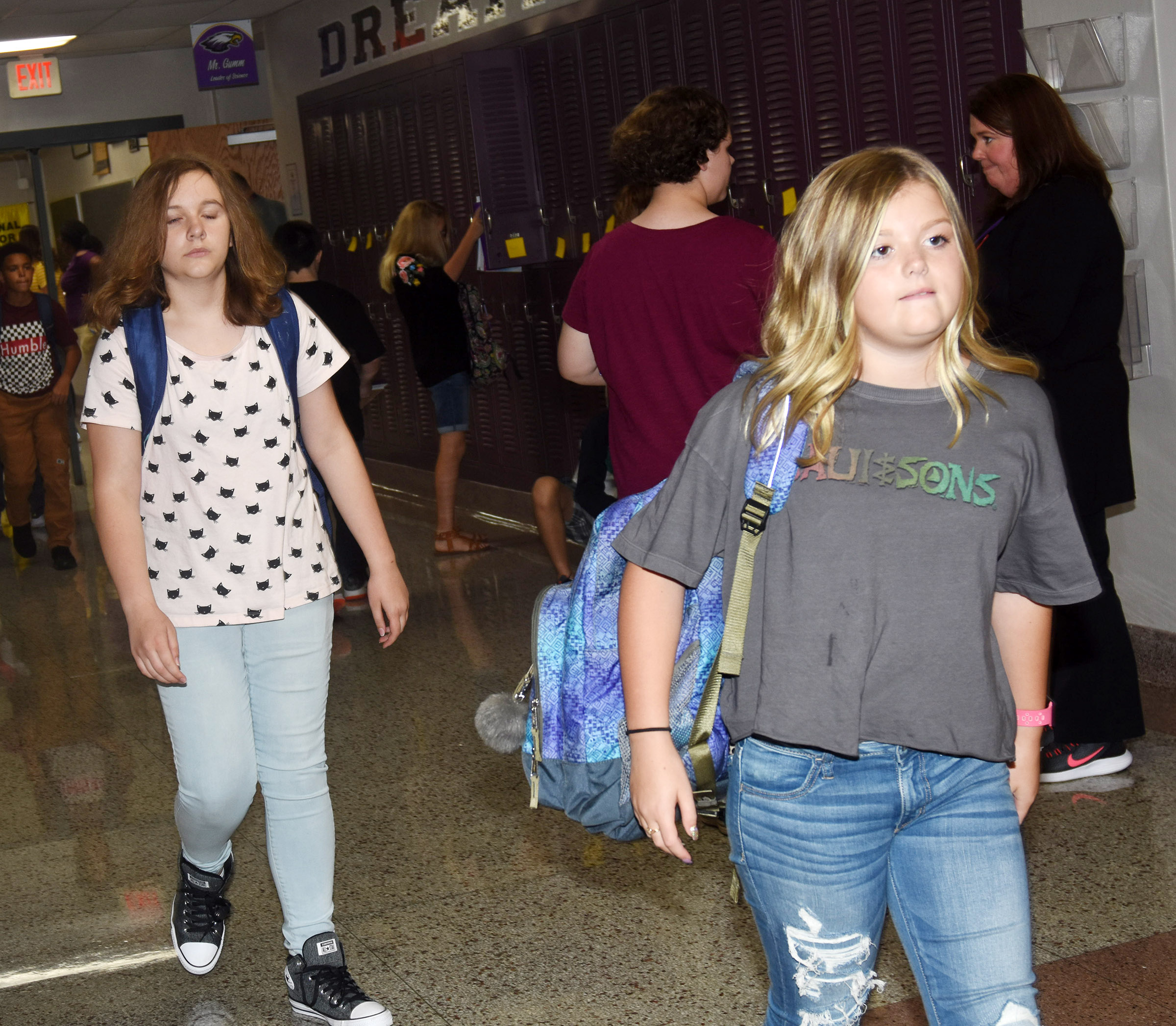 Campbellsville Middle School seventh-grader Ellington Gowin walks down the hallway as she and her classmates prepare to go home.