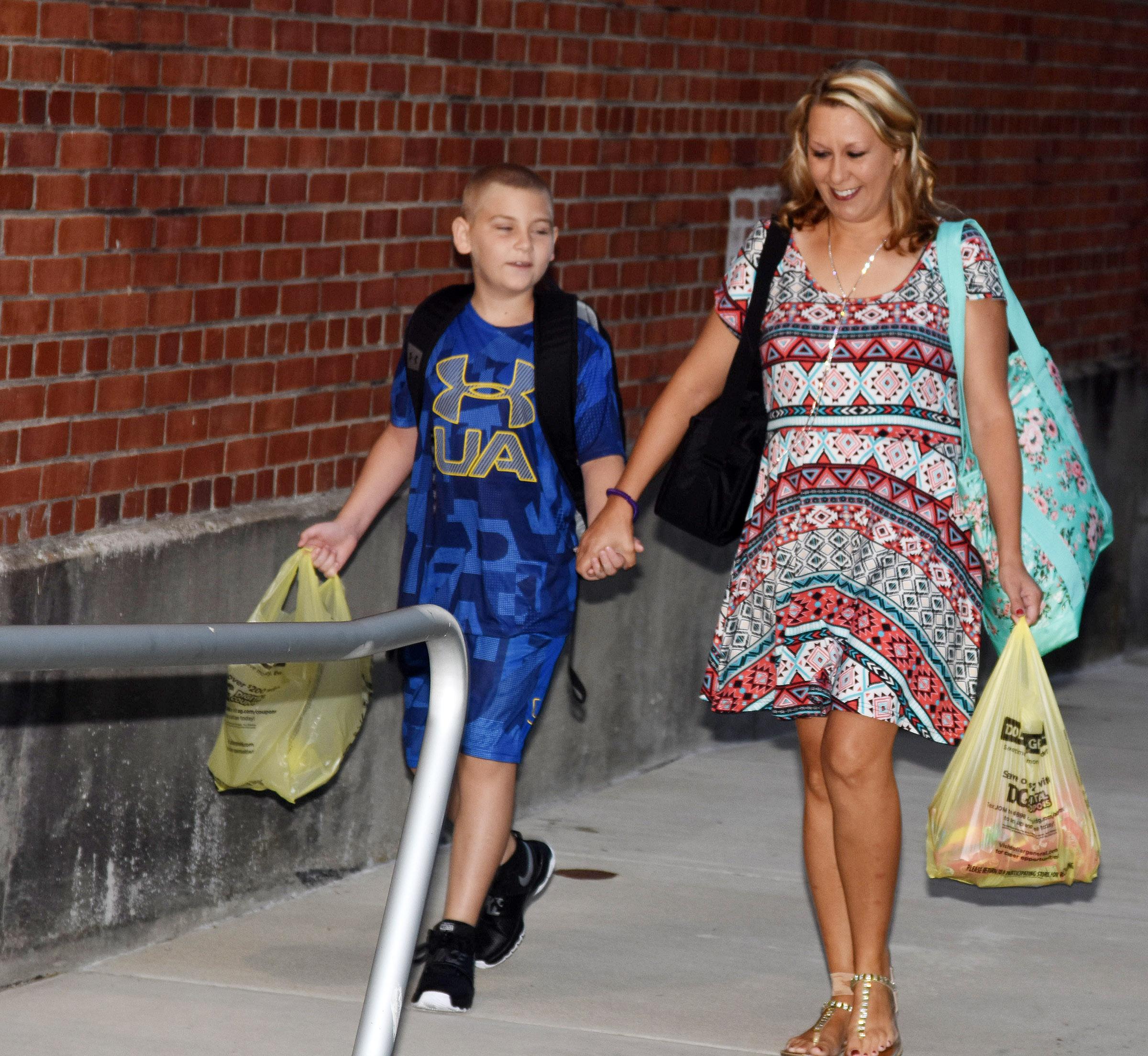 Campbellsville Elementary School teacher Amanda Greer walks in with her son Joseph, a fourth-grader.